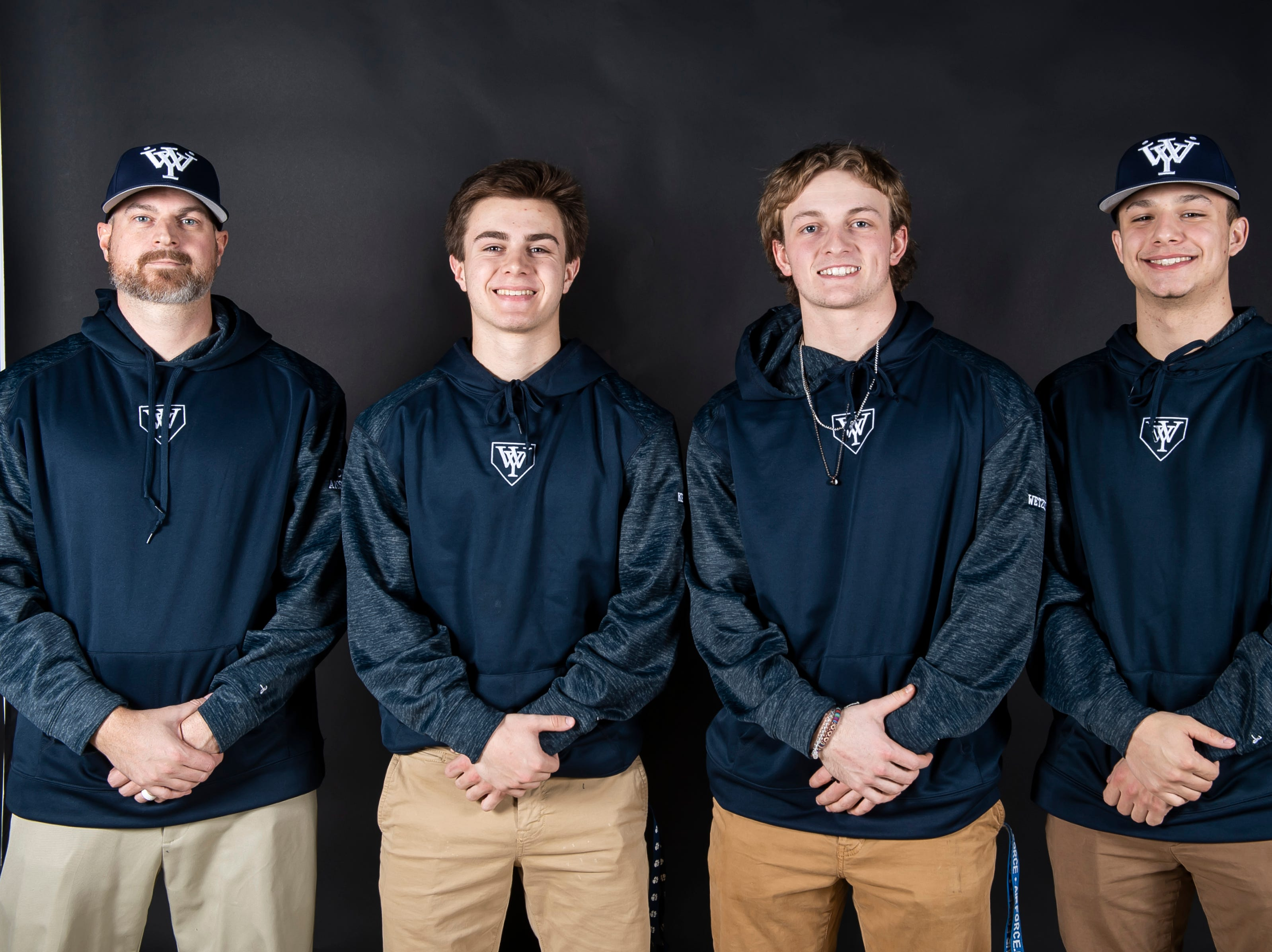 (From left) West York baseball coach Erik Amspacher and players players Trent Ketterman, Justin Wetzel and Elias Blue pose in the GameTimePA photo booth during spring sports media day in York Sunday, March 10, 2019.
