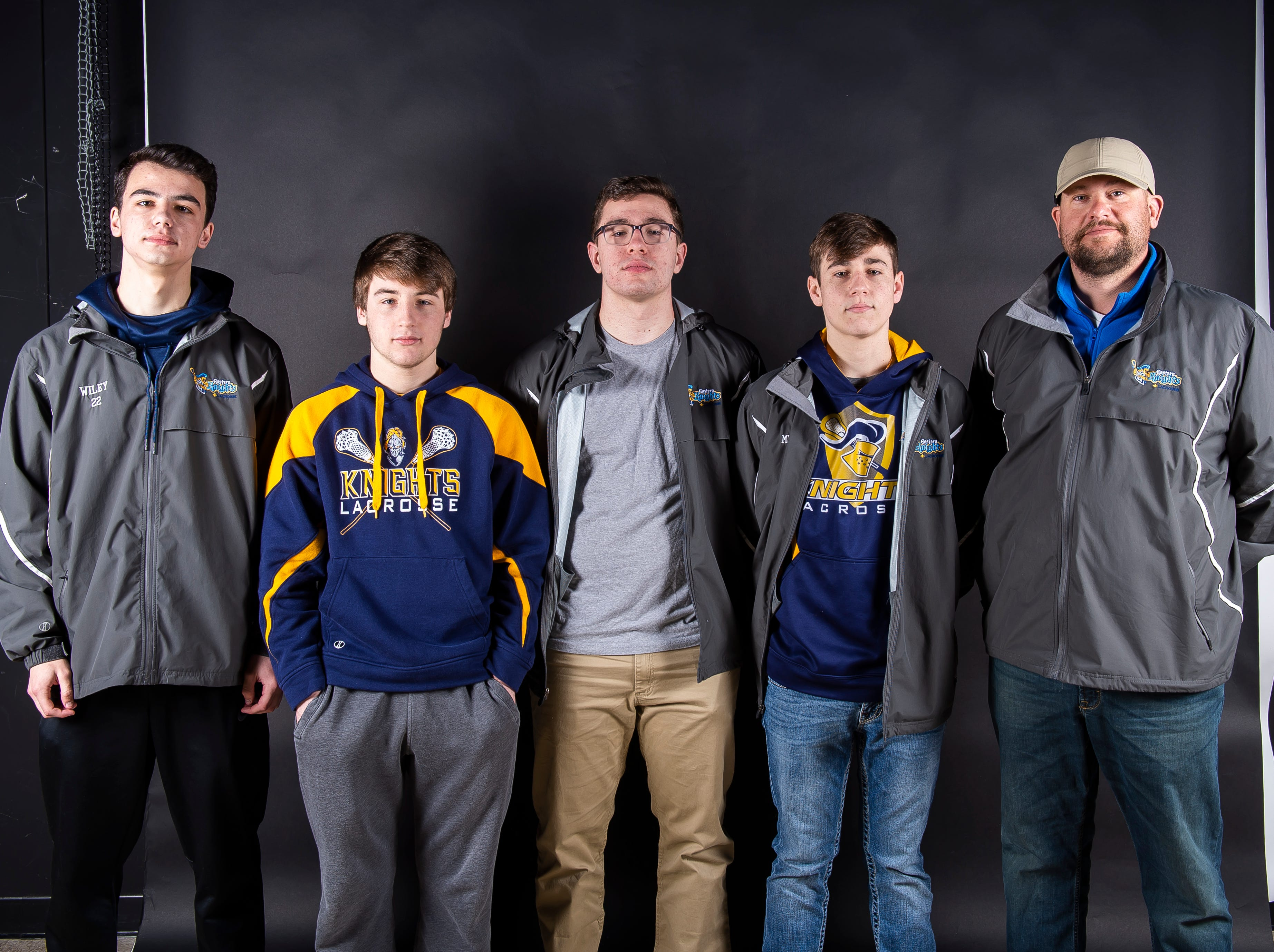 (From left) Eastern York lacrosse players Kade Wiley, Jake Crumling, Zach Grove and Cadeyn Micahel pose with coach Aaron Bankowski in the GameTimePA photo booth during spring sports media day in York Sunday, March 10, 2019.