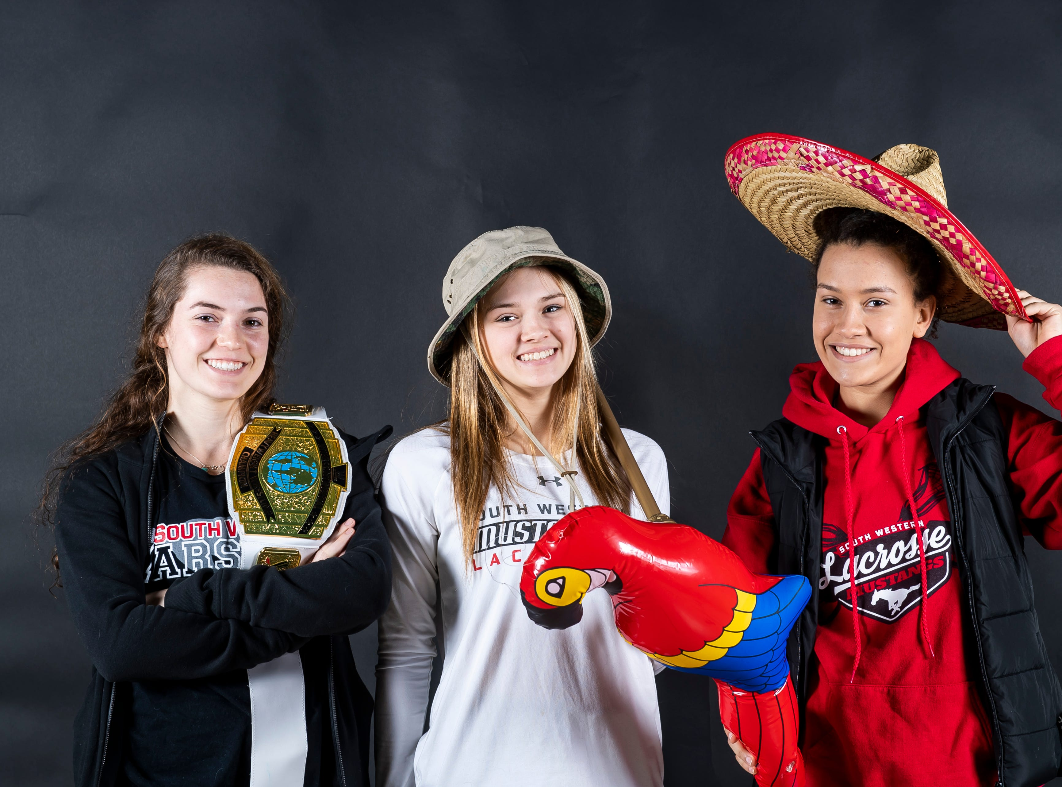 (From left) South Western lacrosse players Jordan Gertz, Caitlyn Coates and Sophie Mace strike a pose in the GameTimePA photo booth during spring sports media day in York Sunday, March 10, 2019.