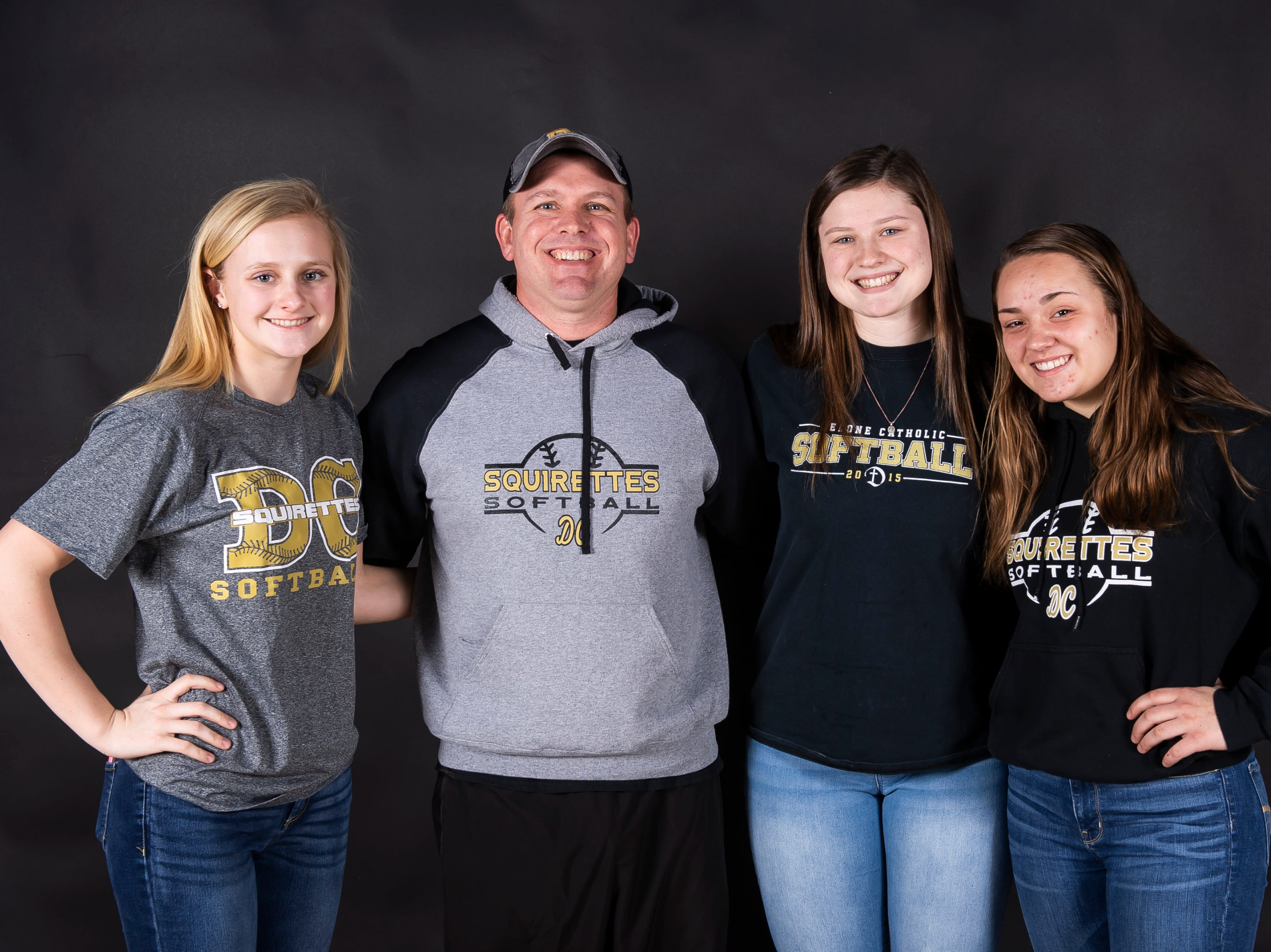 (From left) Delone Catholic softball's Lauren Little, coach Matt Rickrode, Maggie Rickrode and Katie Ernst pose in the GameTimePA photo booth during spring sports media day in York Sunday, March 10, 2019.