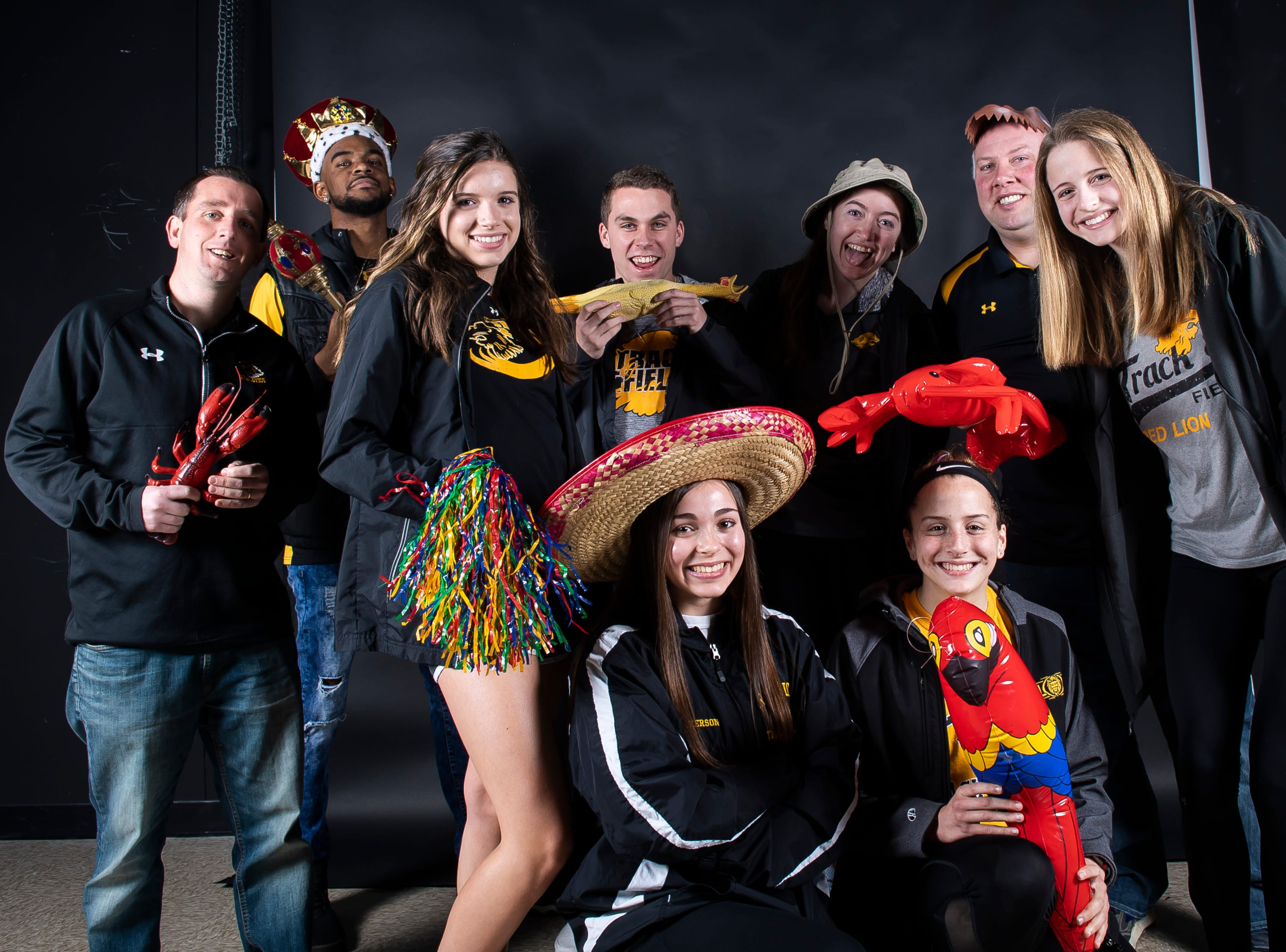 The Red Lion track and field team strike a pose in the GameTimePA photo booth during spring sports media day in York Sunday, March 10, 2019.