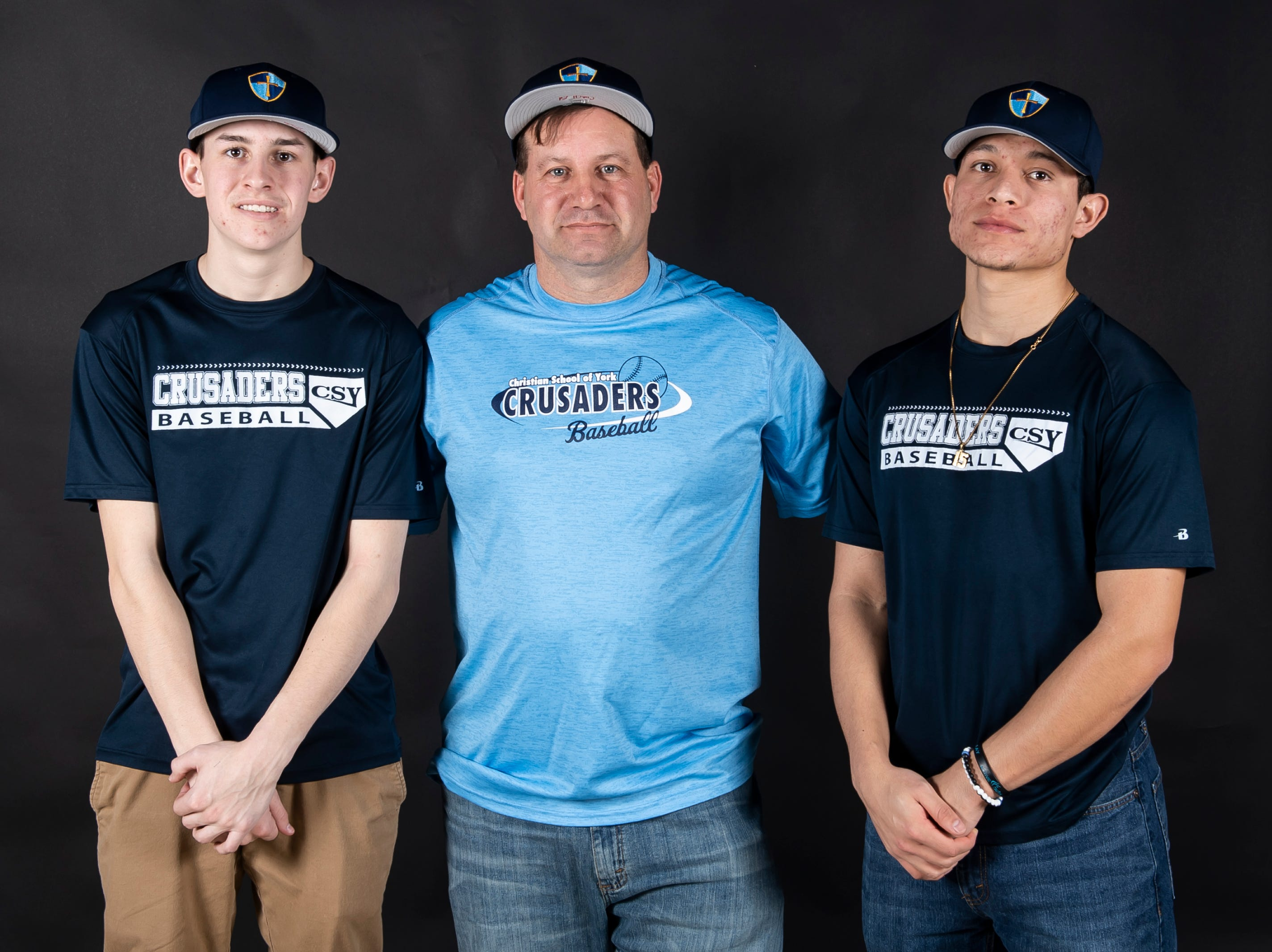 (From left) Christian School of York baseball's Lane Ferrence, coach Ed Bills and Neco Velasco pose in the GameTimePA photo booth during spring sports media day in York Sunday, March 10, 2019.