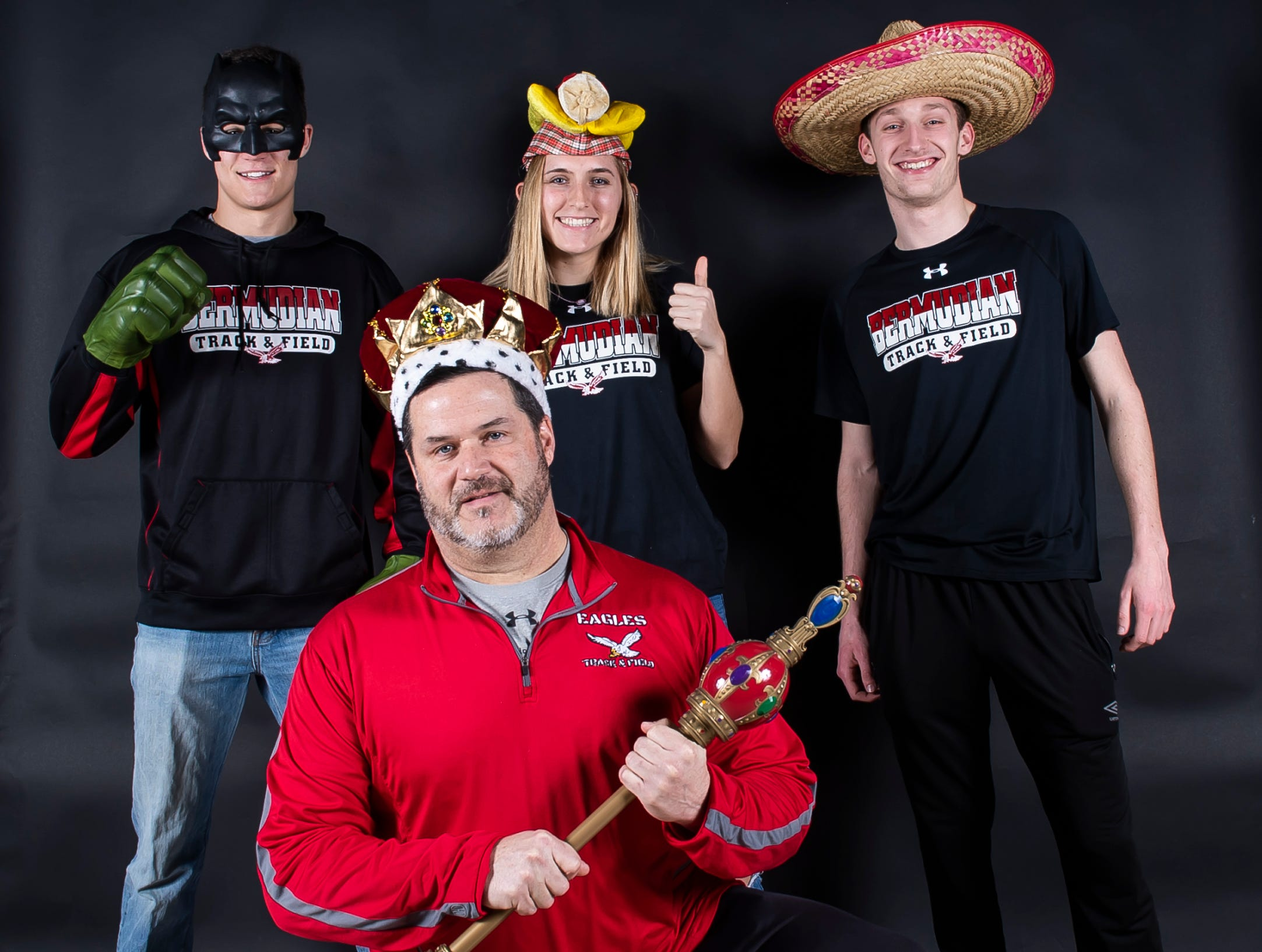 Bermudian Springs track and field athletes Thomas Bross, Kayla Pyles and Payton Rohrbaugh strike a pose with coach Chris King in the GameTimePA photo booth during spring sports media day in York Sunday, March 10, 2019.