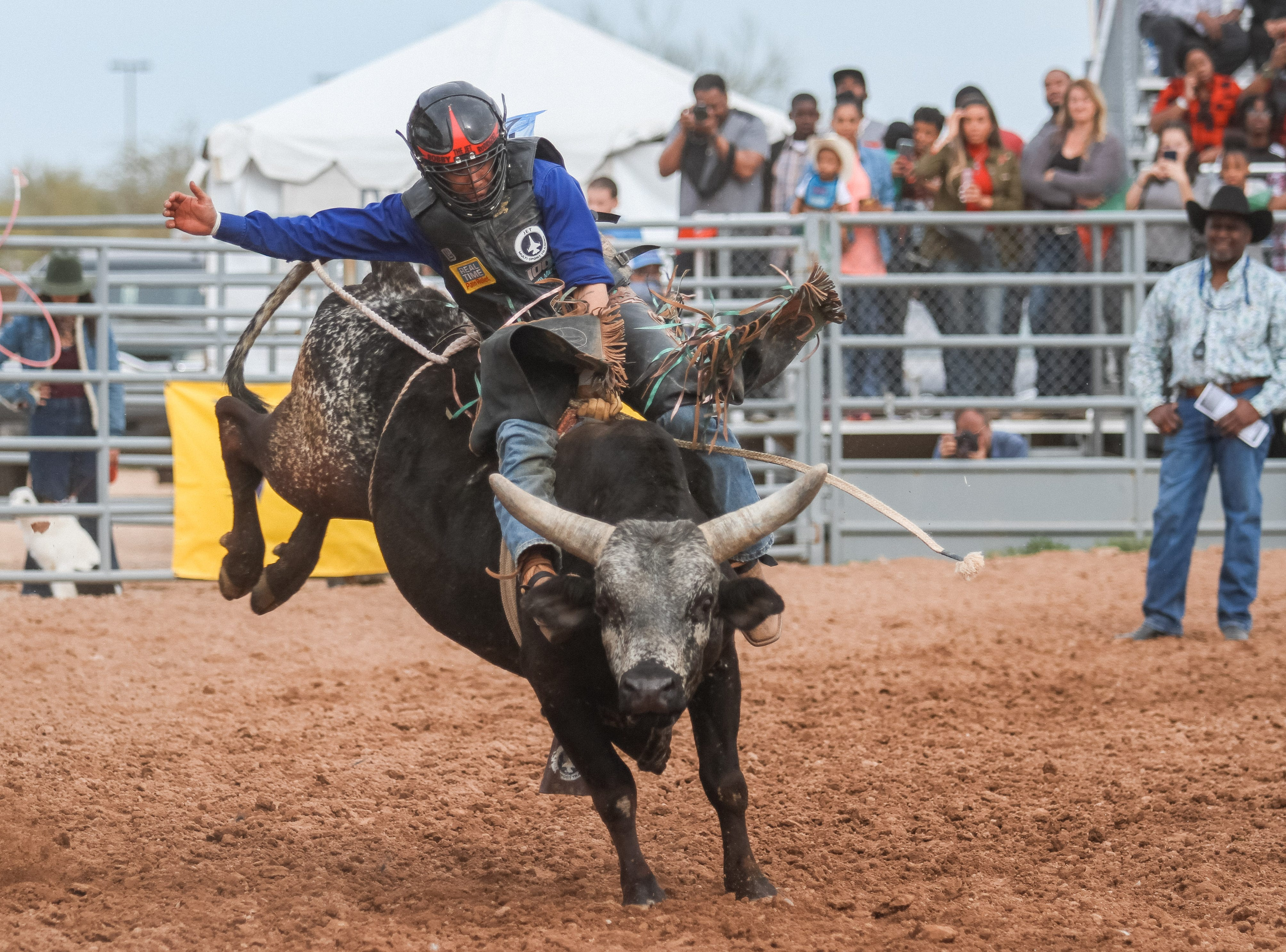 """Bobby """"The Jet"""" Rodriguez rides a bucking bull at the Arizona Black Rodeo in Chandler, Arizona on Saturday, March 9, 2019."""