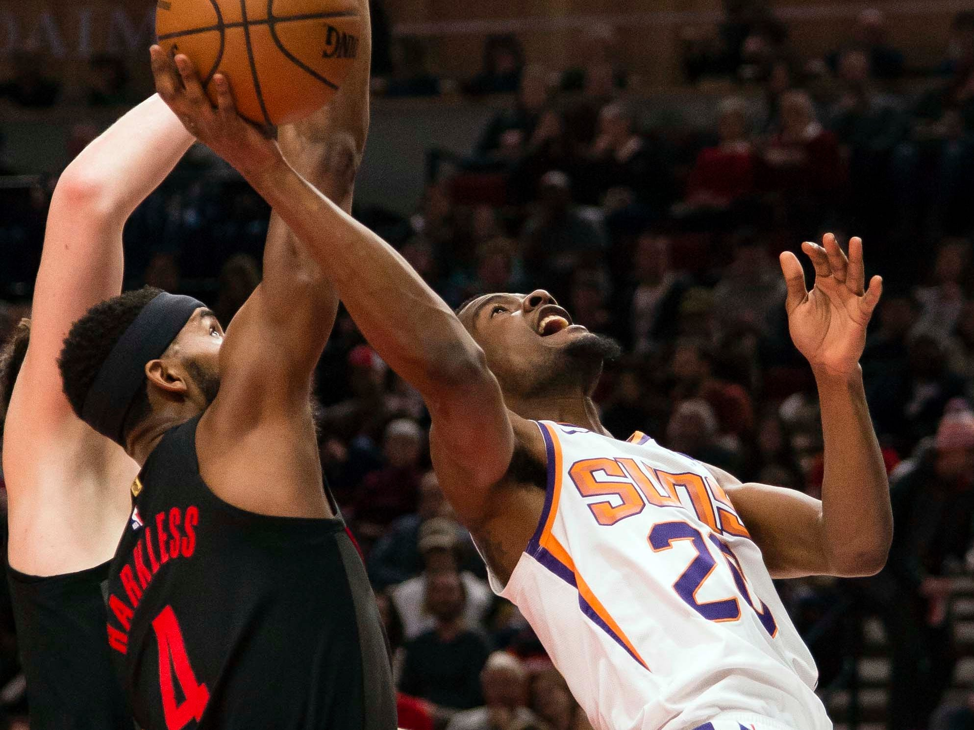 Mar 9, 2019; Portland, OR, USA; Phoenix Suns forward Josh Jackson (20) puts up a shot against Portland Trail Blazers forward Maurice Harkless (4) during the first half at Moda Center.