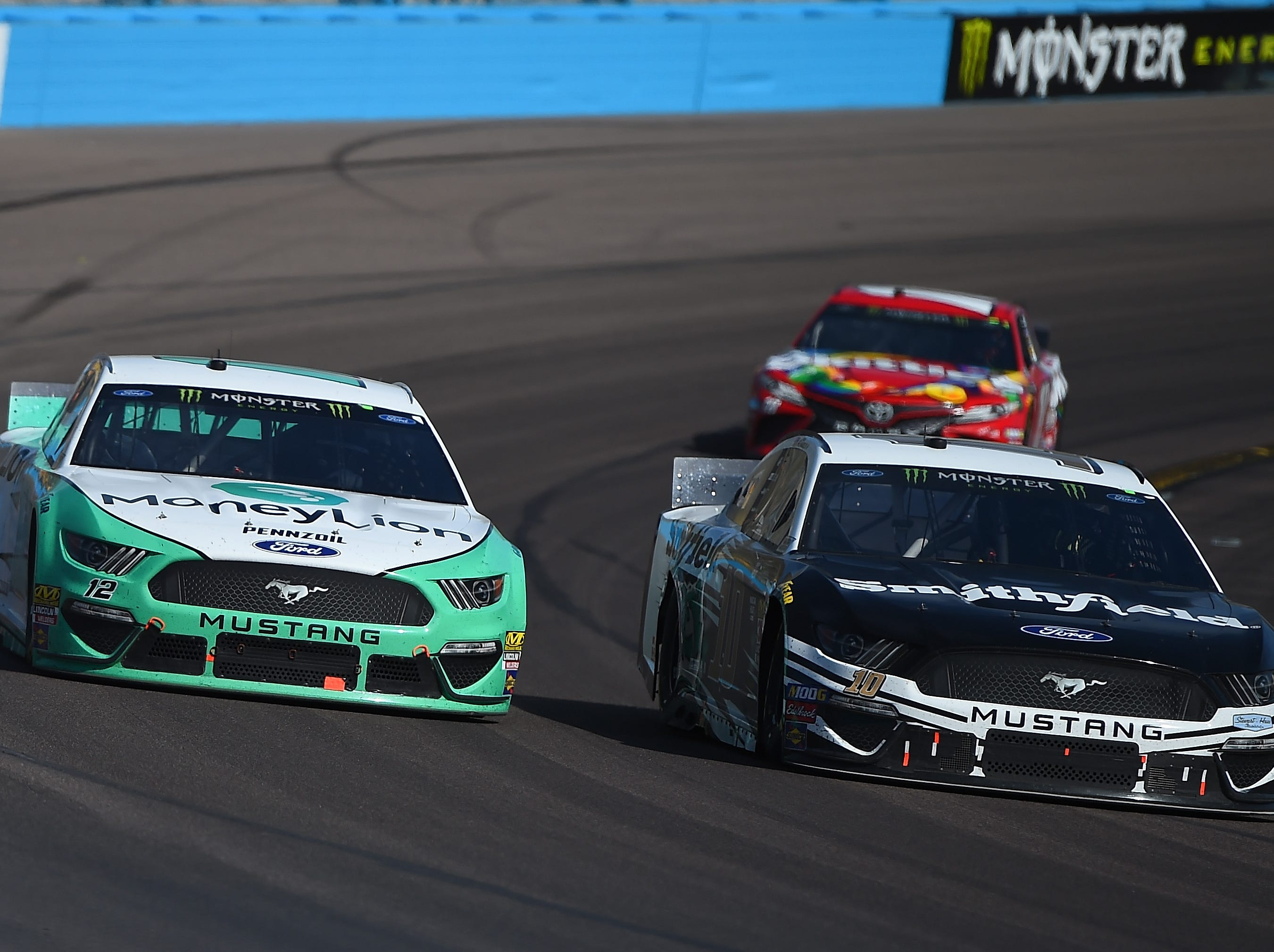 AVONDALE, AZ - MARCH 10:  Ryan Blaney, driver of the #12 MoneyLion Ford, and Aric Almirola, driver of the #10 Smithfield Ford, race during the Monster Energy NASCAR Cup Series TicketGuardian 500 at ISM Raceway on March 10, 2019 in Avondale, Arizona.  (Photo by Stacy Revere/Getty Images)