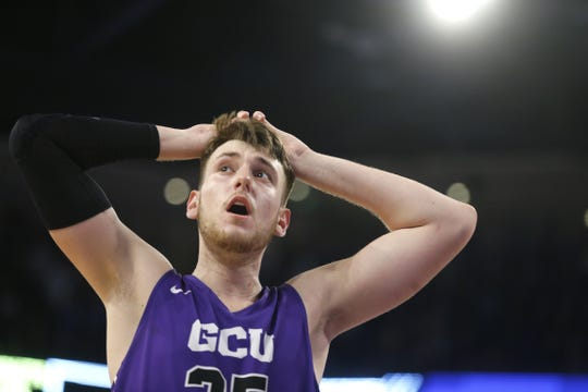 GCU's Alessandro Lever (25) reacts and looks up at the scoreboard as the team fouls down two points to New Mexico State late during the second half at Grand Canyon University Arena in Phoenix, Ariz. on February 9, 2019.