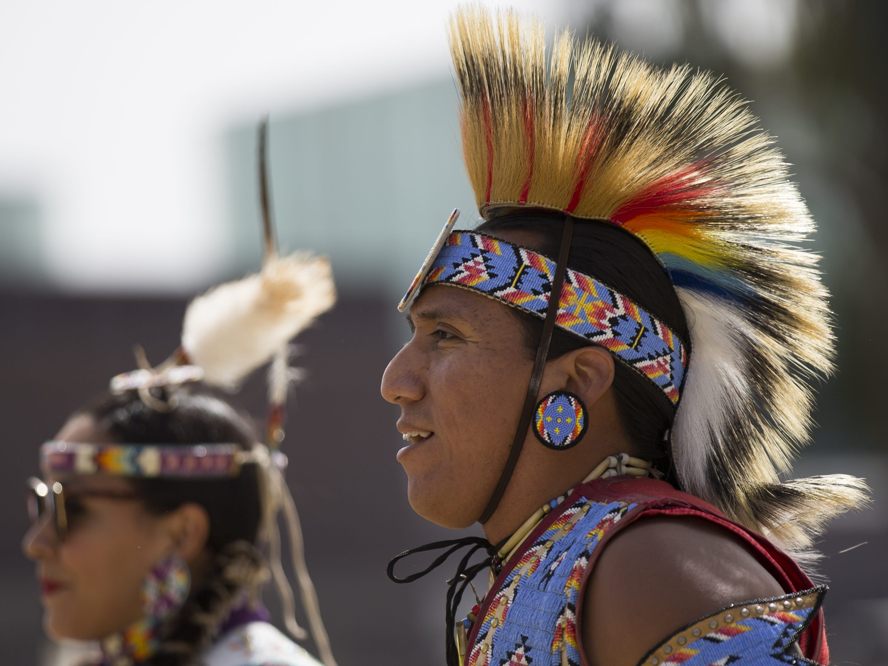World champion hoop dancer Tony Duncan (right) dances at the Native Two Spirit Powwow at South Mountain Community College in Phoenix, Ariz. on Saturday, March 9, 2019. The powwow was the first of its kind in Arizona, featuring members who identified as two spirit, and members who did not, dancing together.
