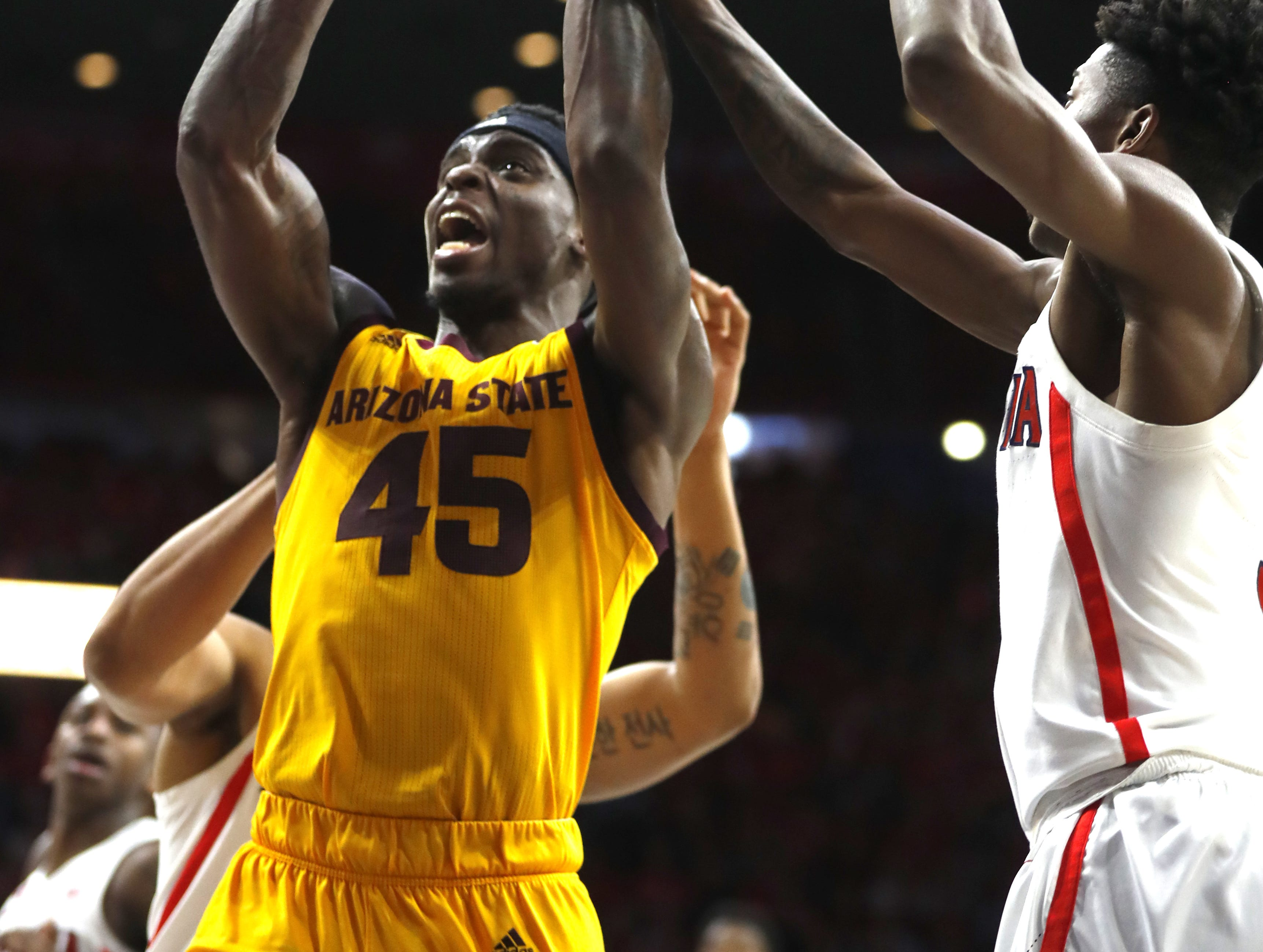 ASU's Zylan Cheatham (45) drives to the basket against Arizona during the second half at the McKale Memorial Center in Tucson, Ariz. on March 9, 2019.