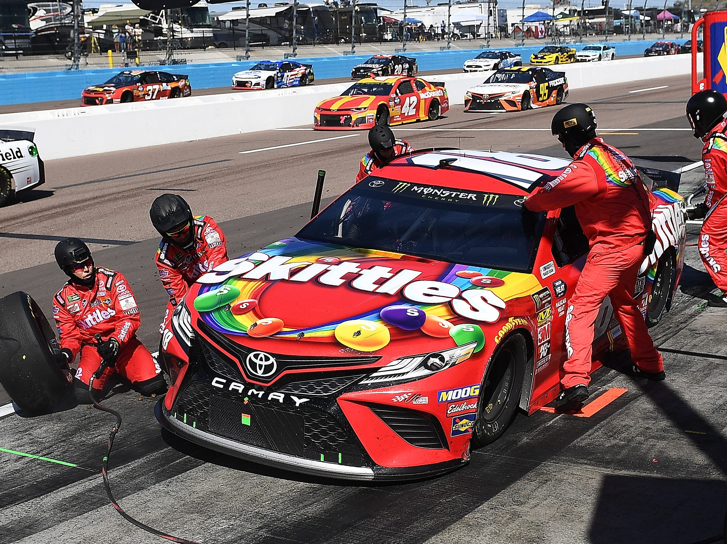 AVONDALE, AZ - MARCH 10:  Kyle Busch, driver of the #18 Skittles Toyota, pits during the Monster Energy NASCAR Cup Series TicketGuardian 500 at ISM Raceway on March 10, 2019 in Avondale, Arizona.  (Photo by Stacy Revere/Getty Images)