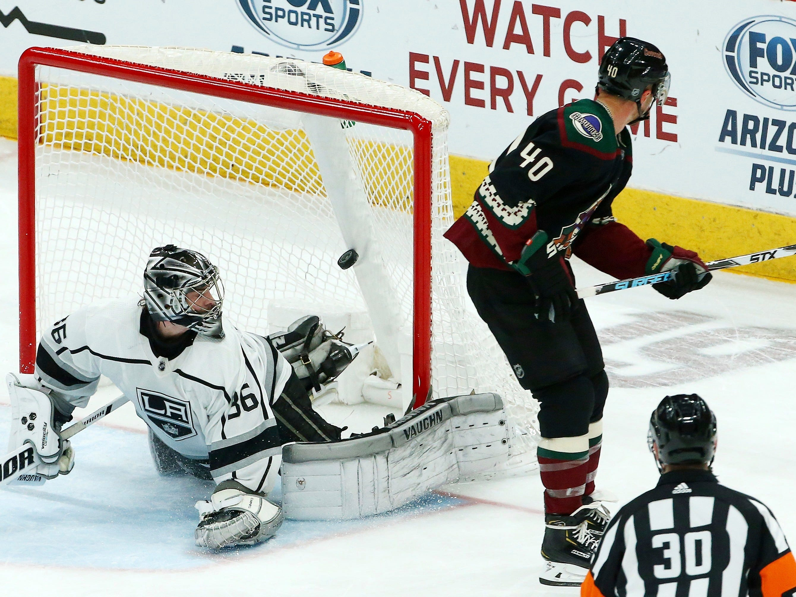 Arizona Coyotes right wing Michael Grabner (40) scores a goal against Los Angeles Kings goaltender Jack Campbell (36) as referee Kendrick Nicholson (30) looks on during the third period of an NHL hockey game Saturday, March 9, 2019, in Glendale, Ariz. The Coyotes defeated the Kings 4-2.