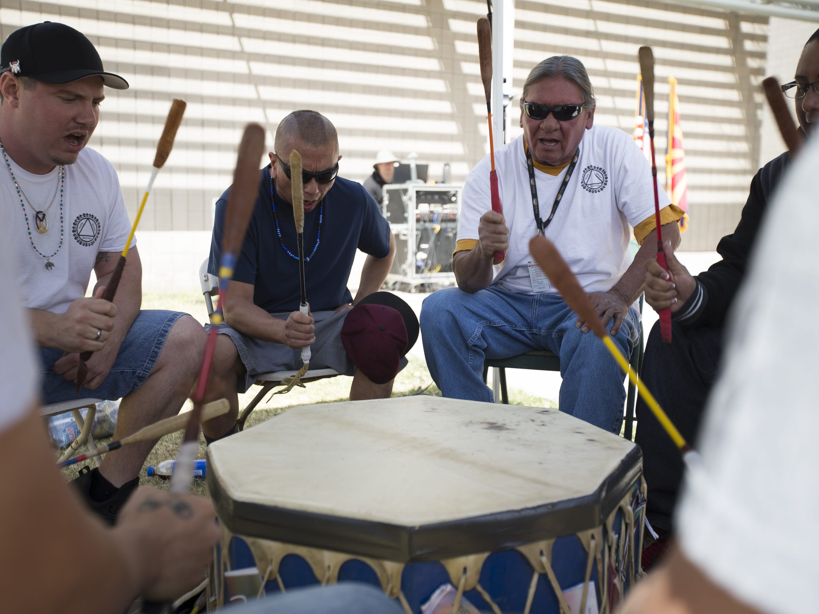A drum group performs at the Native Two Spirit Powwow at South Mountain Community College in Phoenix, Ariz. on Saturday, March 9, 2019. The powwow was the first of its kind in Arizona, featuring members who identified as two spirit, and members who did not, dancing together.