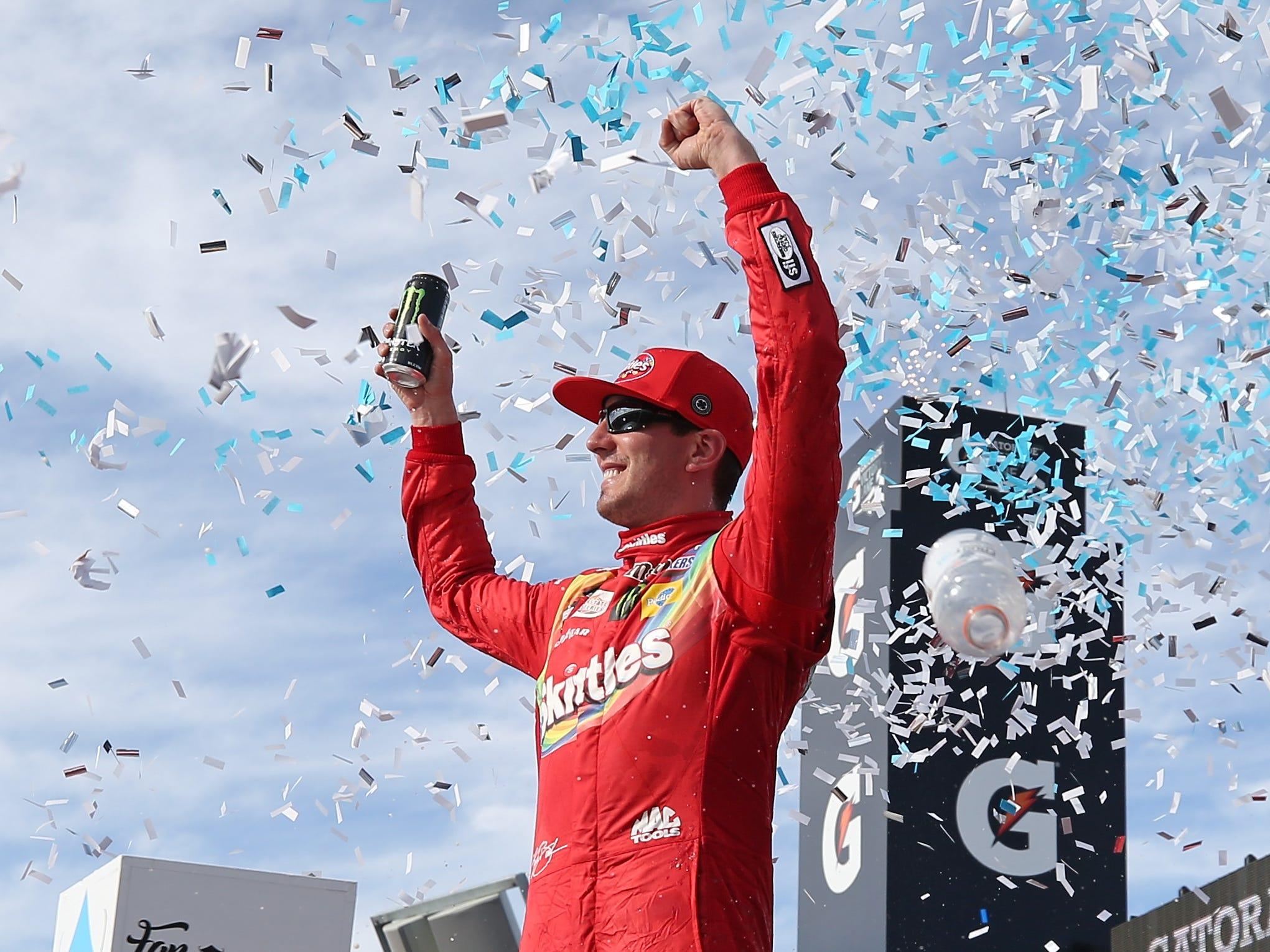 AVONDALE, AZ - MARCH 10:  Kyle Busch, driver of the #18 Skittles Toyota, celebrates in Victory Lane after winning the Monster Energy NASCAR Cup Series TicketGuardian 500 at ISM Raceway on March 10, 2019 in Avondale, Arizona.  (Photo by Matt Sullivan/Getty Images)