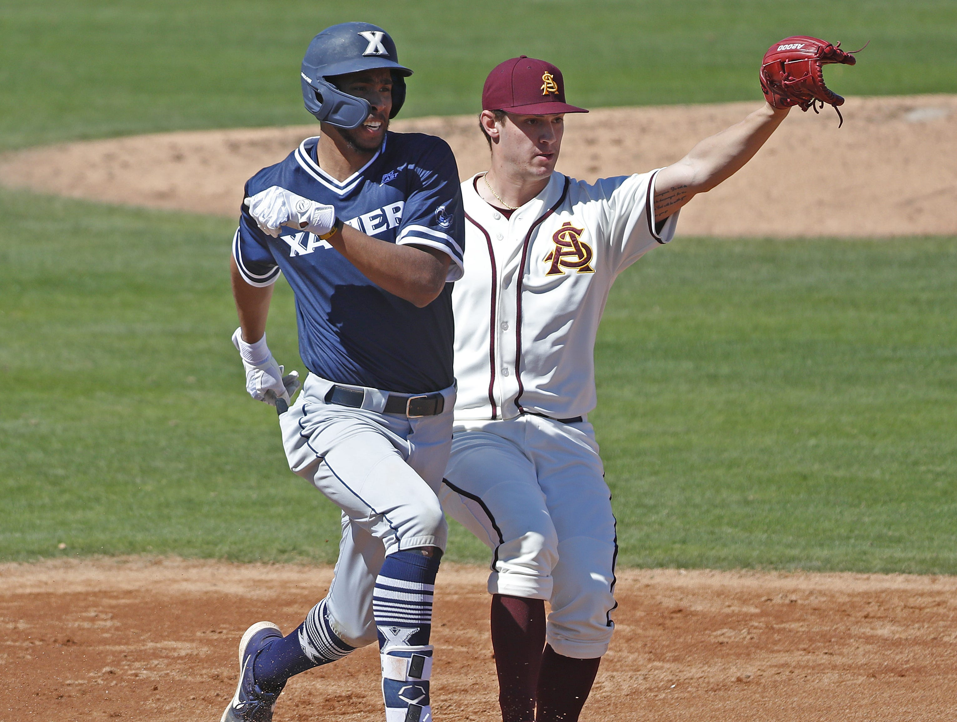 ASU's RJ Dabovich (11) catches the ball for a force out on Xavier's Allbry Major (34) during a game against Xavier at Phoenix Municipal Stadium in Phoenix, Ariz. on March 10, 2019.
