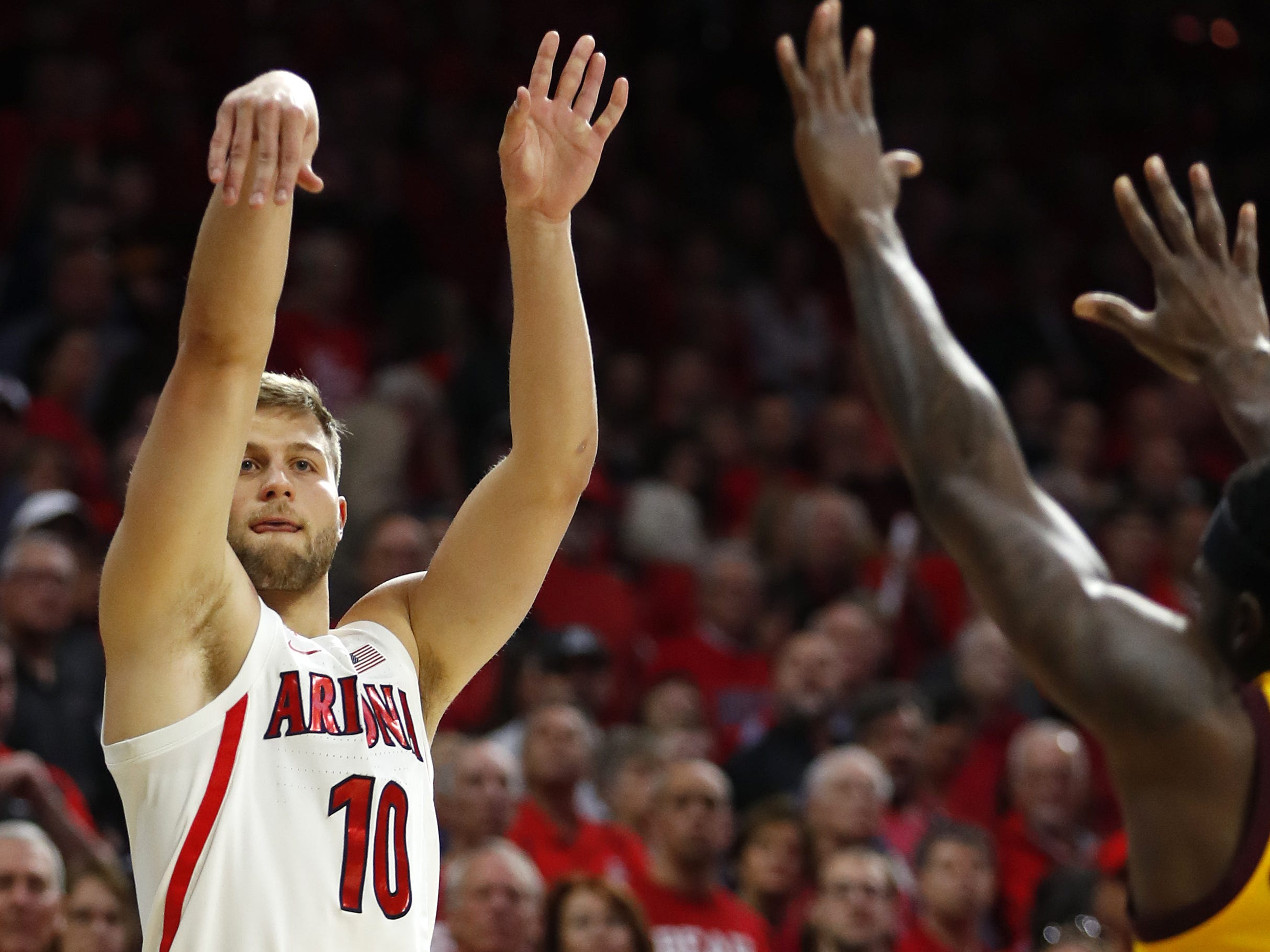 Arizona's Ryan Luther (10) makes a three pointer against ASU during the first half at the McKale Memorial Center in Tucson, Ariz. on March 9, 2019.