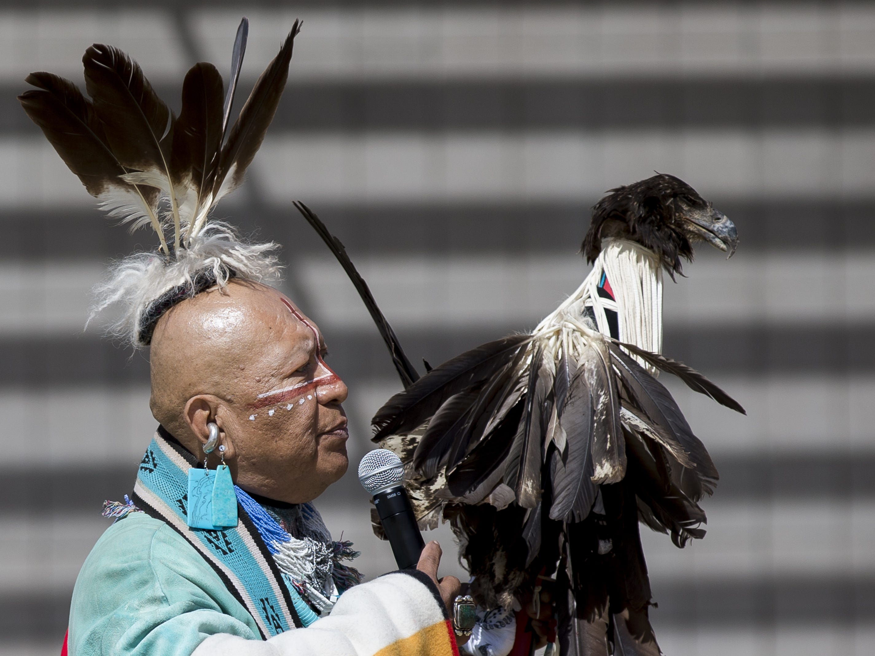 Havasupai medicine man Uqualla blesses the grounds before the Native Two Spirit Powwow at South Mountain Community College in Phoenix, Ariz. on Saturday, March 9, 2019. The powwow was the first of its kind in Arizona, featuring members who identified as two spirit, and members who did not, dancing together.