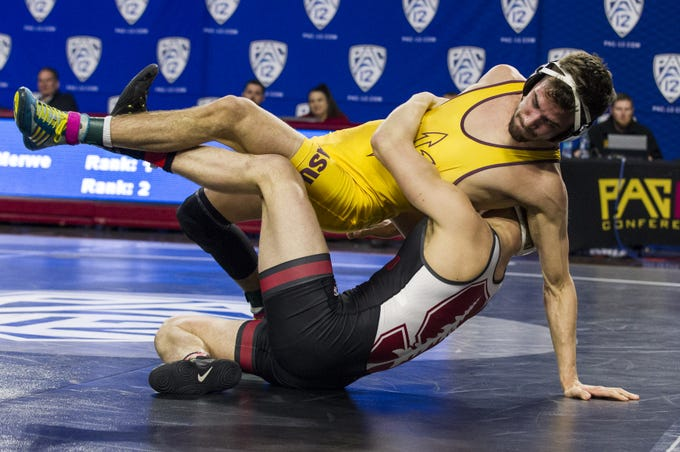 ASU's Joshua Maruca gets wrapped up with Stanford's  Requir Van Der Merwe in the 149 pound weight class during the Pac 12 Wrestling Championship at Wells Fargo Arena in Tempe on March 9, 2019.