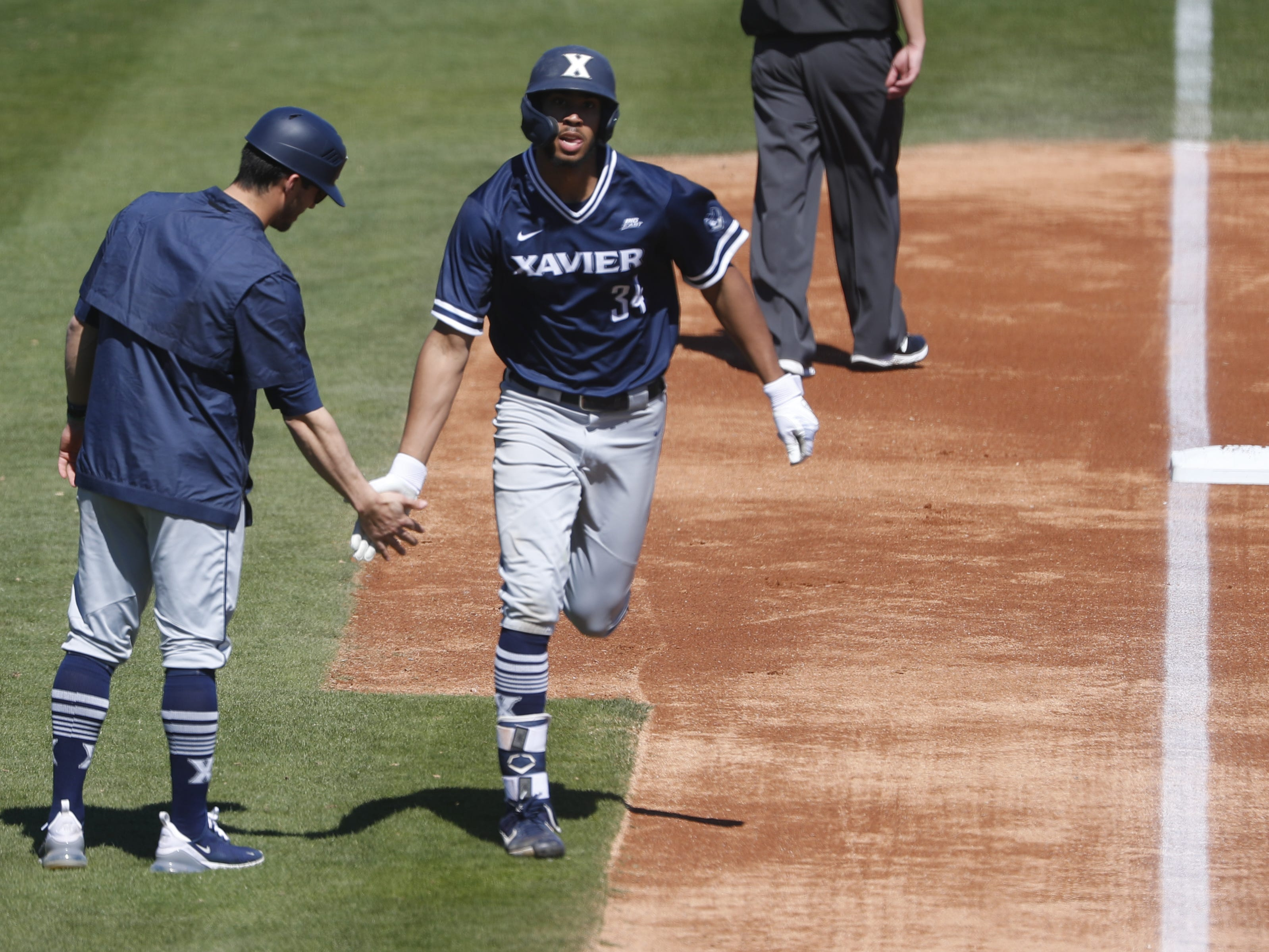 Xavier's Allbry Major (34) rounds third base after hitting a solo home run during the second inning against ASU at Phoenix Municipal Stadium in Phoenix, Ariz. on March 10, 2019.