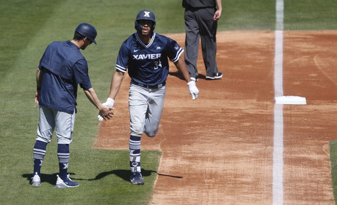 Xavier's Allbry Major (34) rounds third base after hitting a solo home run during the second inning against ASU at Phoenix Municipal Stadium in Phoenix on March 10, 2019.