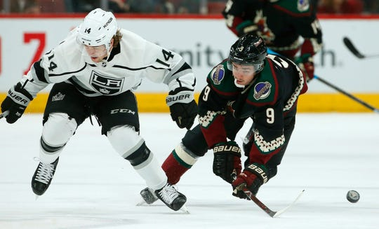 Los Angeles Kings left wing Brendan Leipsic (14) battles with Arizona Coyotes center Clayton Keller (9) for the puck during the first period of an NHL hockey game Saturday, March 9, 2019, in Glendale, Ariz.