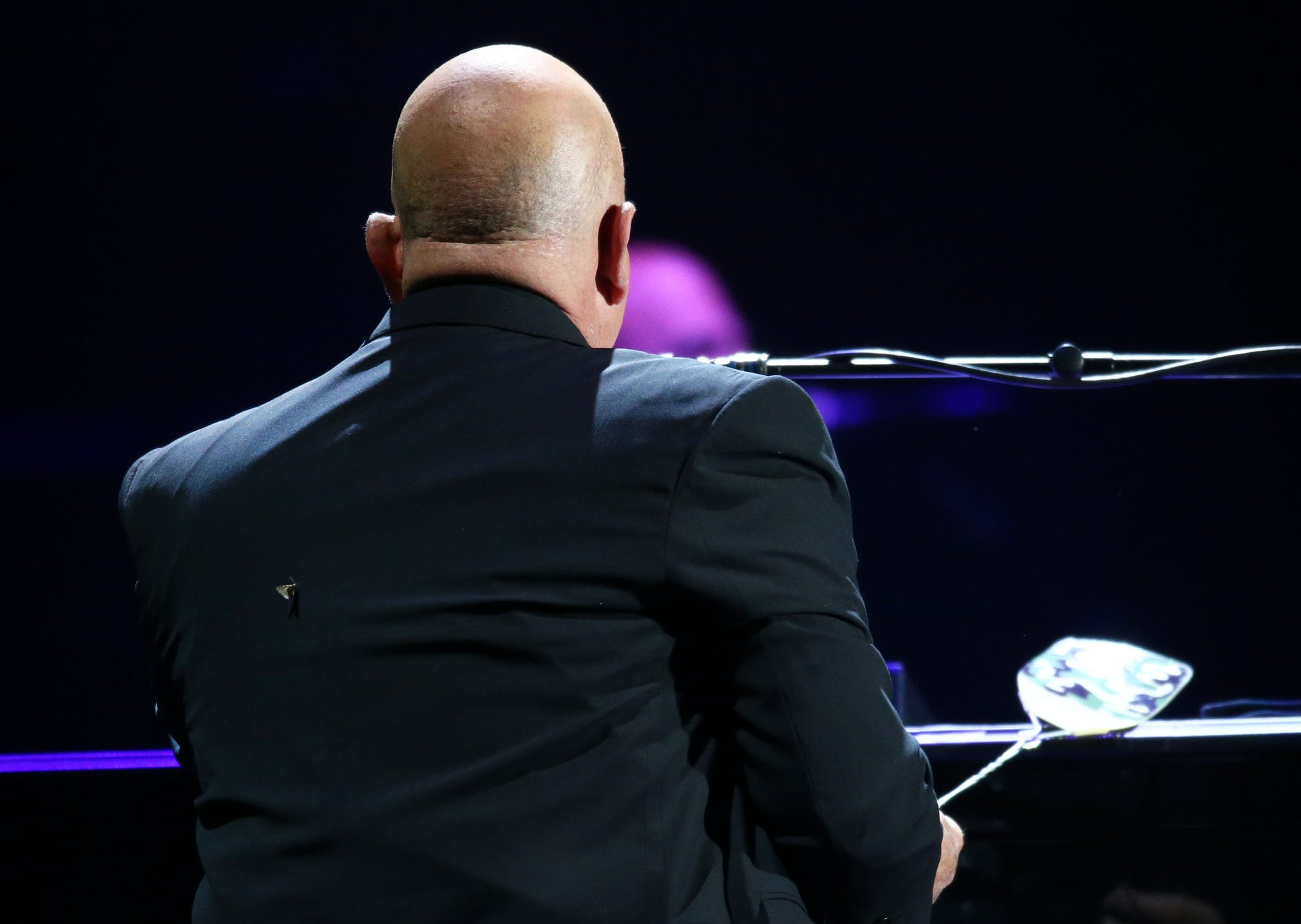 Musician Billy Joel performs while swatting little white moths at Chase Field on March 9, 2019 in Phoenix.