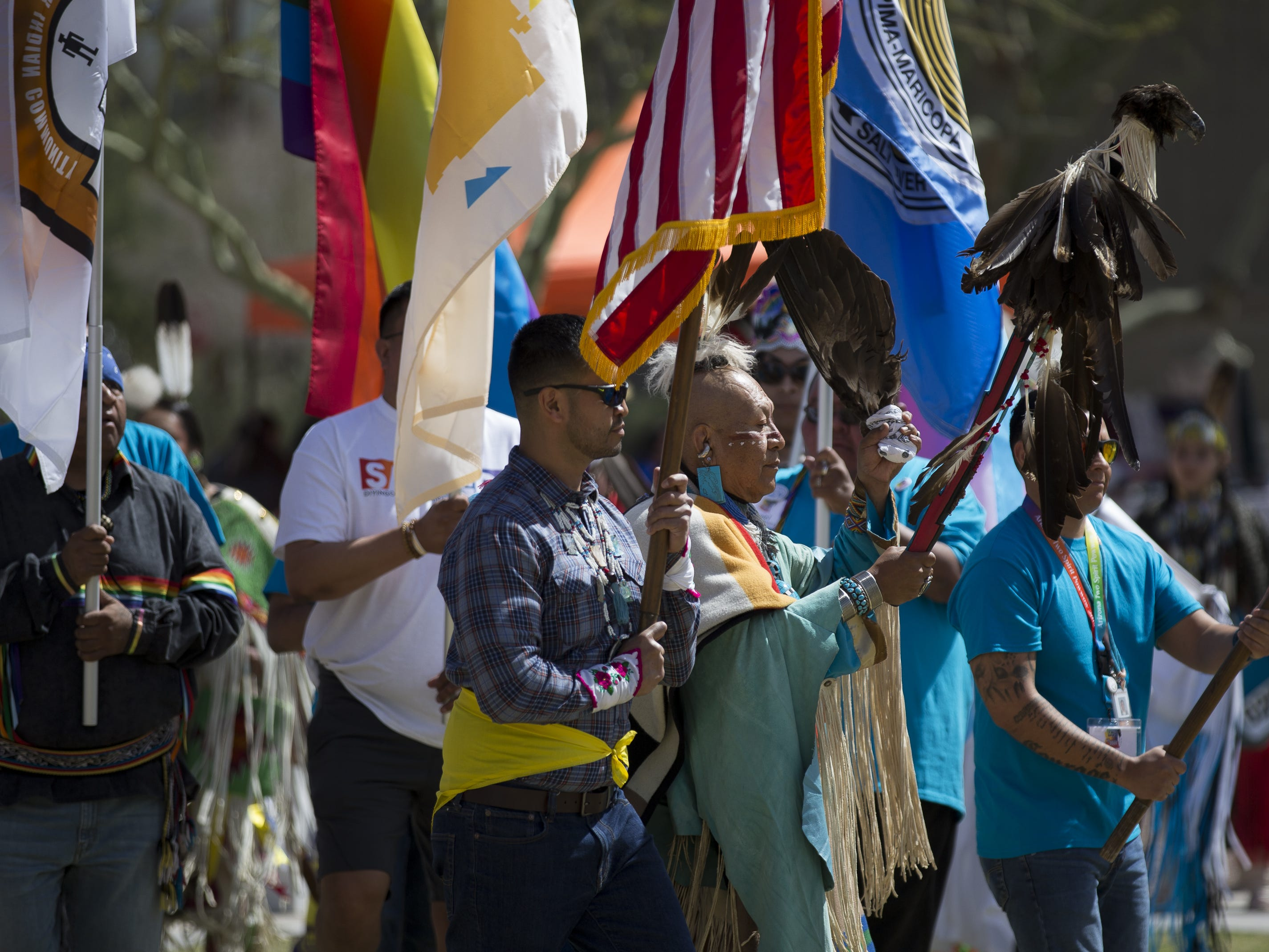 Flags are carried at the start of the Native Two Spirit Powwow at South Mountain Community College in Phoenix, Ariz. on Saturday, March 9, 2019. The powwow was the first of its kind in Arizona, featuring members who identified as two spirit, and members who did not, dancing together.