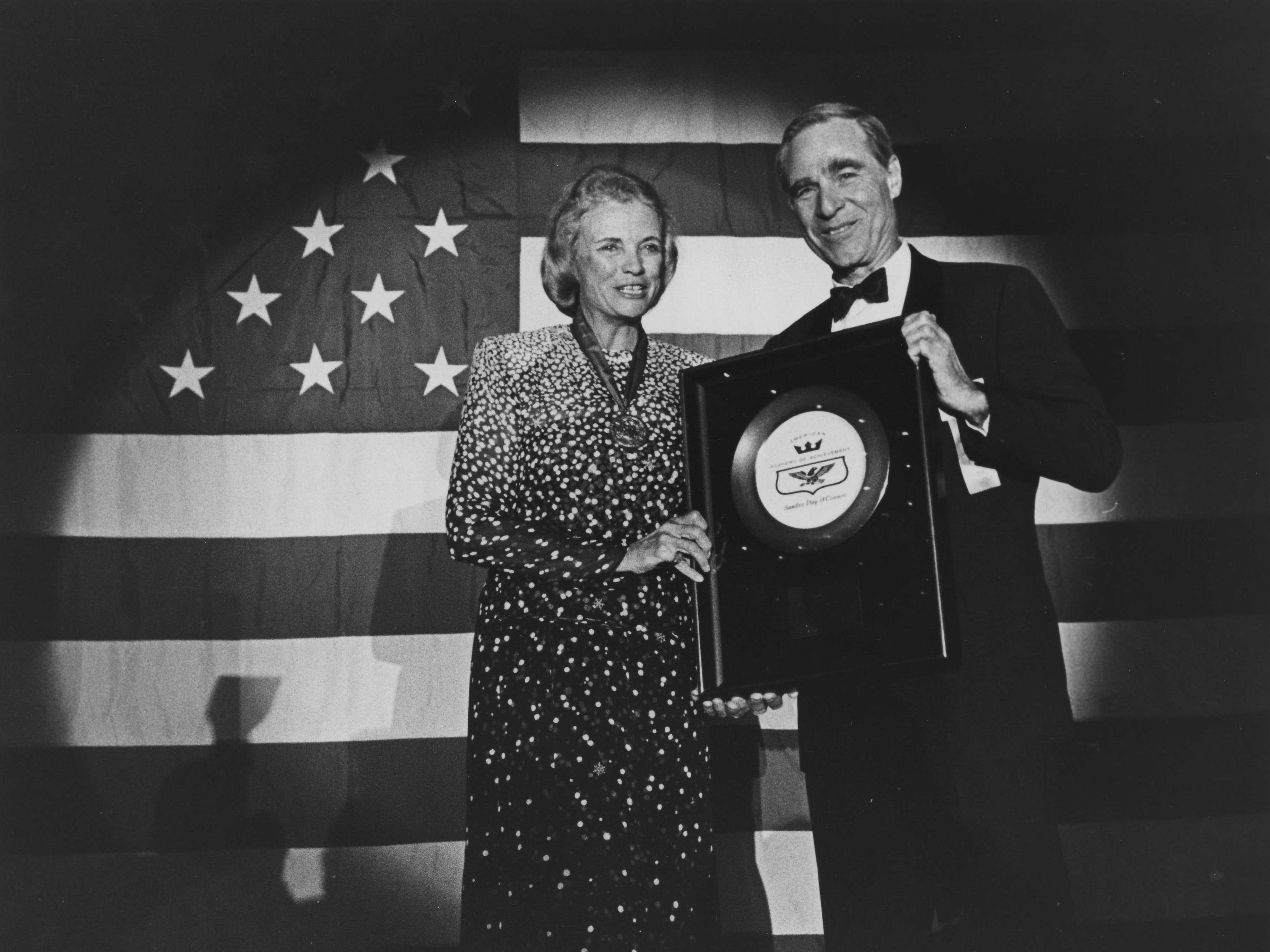 Supreme Court Justice Sandra Day O'Connor receives a Golden Plate Award from host Karl Eller at the banquet for American Academy of Achievement on June 27, 1987, at the Registry Resort in Scottsdale.