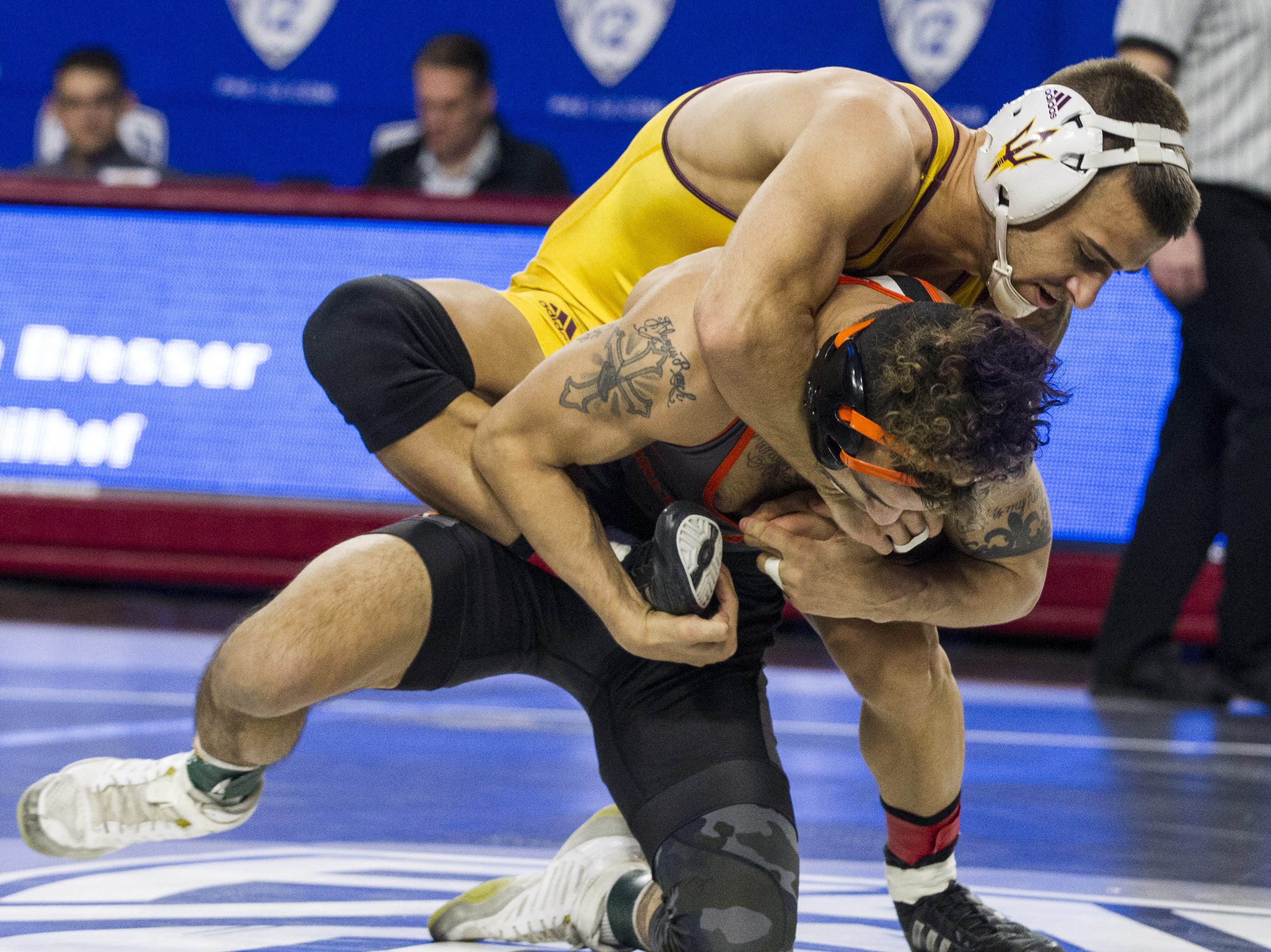 ASU's Ryan Millhof gets the underhand on Oregon State's Ronnie Bresser in the 125 pound weight class during the Pac 12 Wrestling Championship at Wells Fargo Arena in Tempe on March 9, 2019.