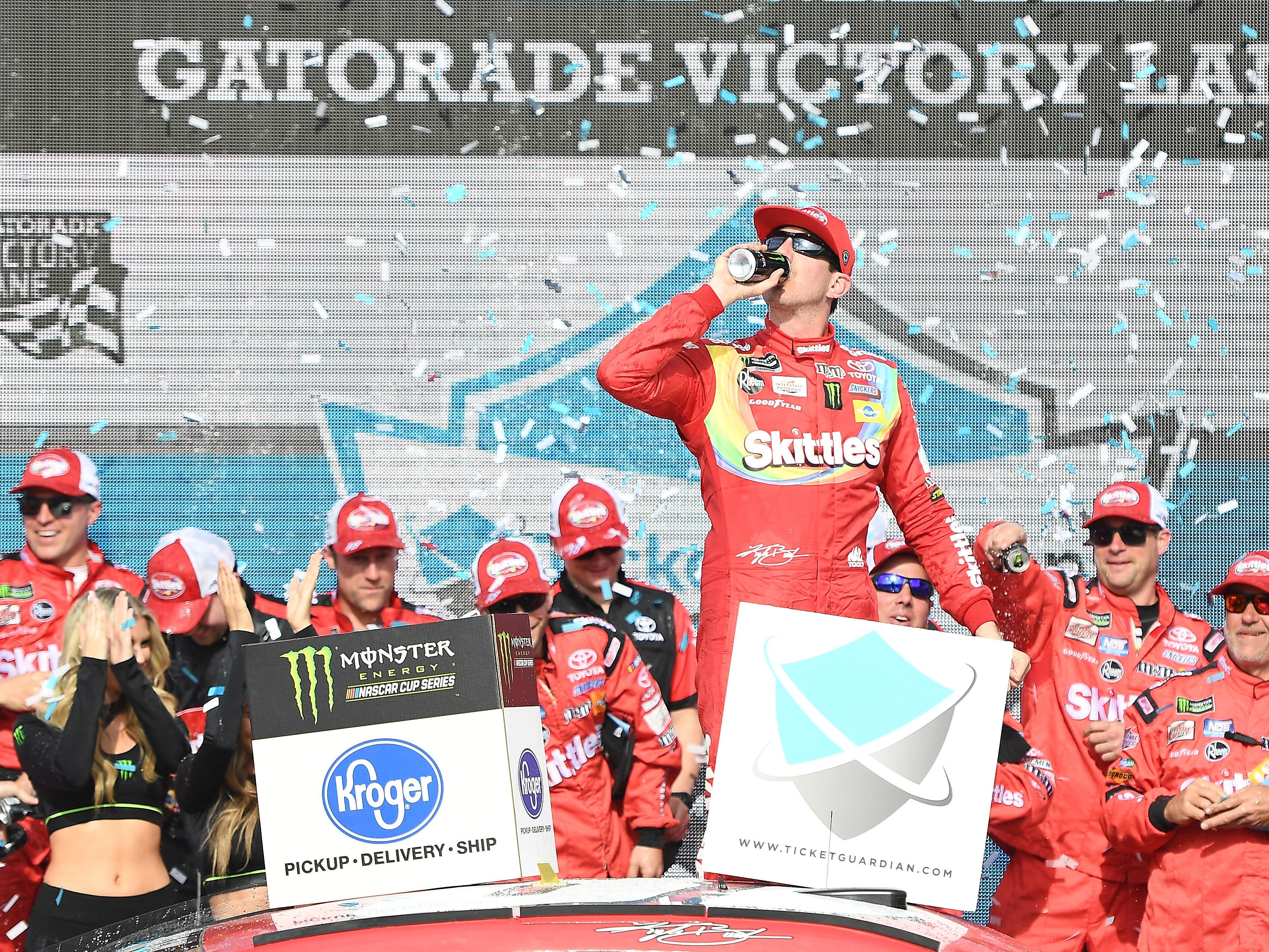 AVONDALE, AZ - MARCH 10:  Kyle Busch, driver of the #18 Skittles Toyota, celebrates in Victory Lane after winning the Monster Energy NASCAR Cup Series TicketGuardian 500 at ISM Raceway on March 10, 2019 in Avondale, Arizona.  (Photo by Stacy Revere/Getty Images)