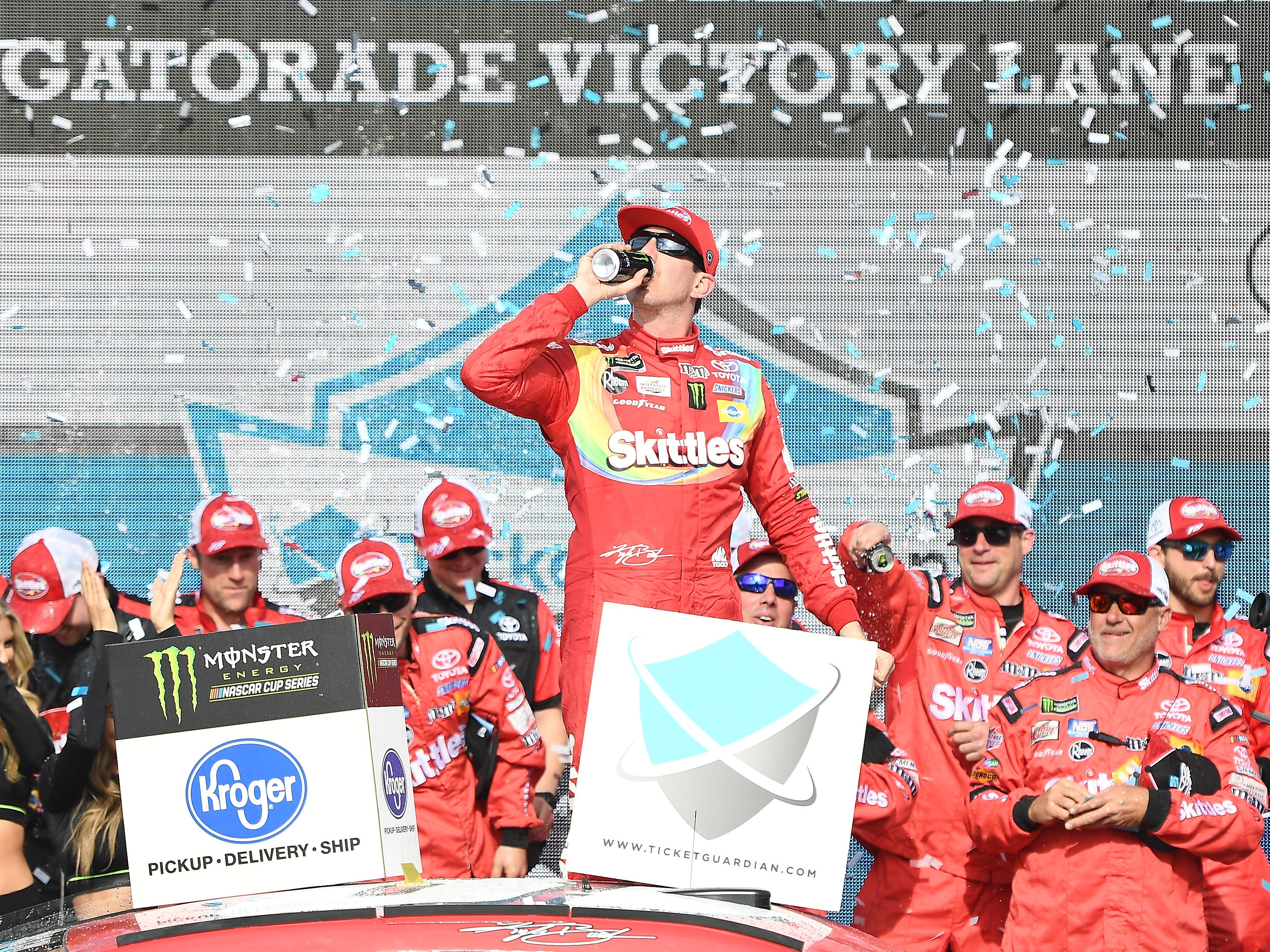 Kyle Busch celebrates after winning a Monster Energy NASCAR Cup Series race at ISM Raceway in Avondale on March 10, 2019.