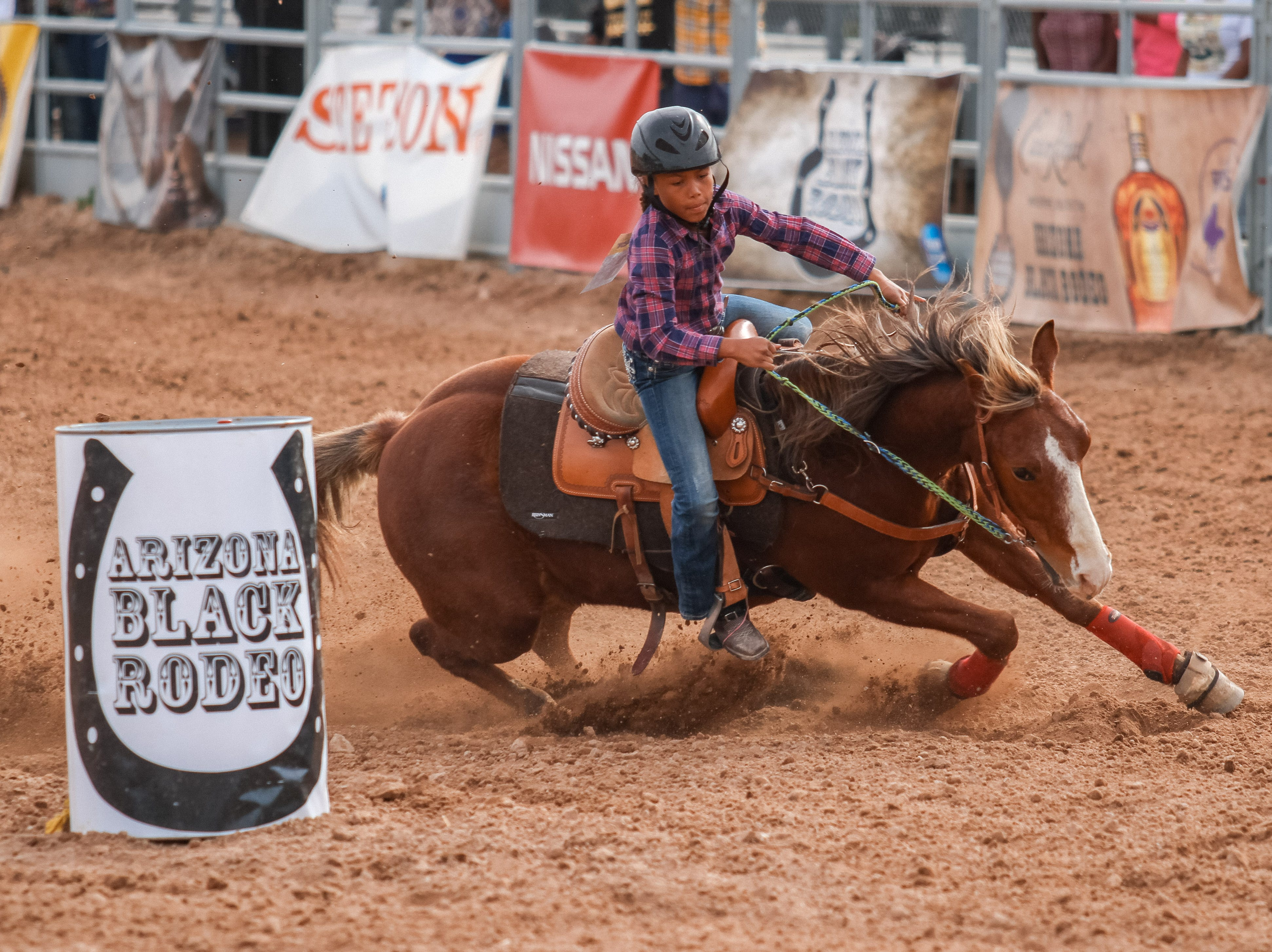 Riders compete in barrel racing at the Arizona Black Rodeo in Chandler, Arizona on Saturday, March 9, 2019.