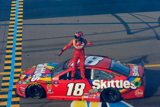 AVONDALE, AZ - MARCH 10:  Kyle Busch, driver of the #18 Skittles Toyota, celebrates winning the Monster Energy NASCAR Cup Series TicketGuardian 500 at ISM Raceway on March 10, 2019 in Avondale, Arizona.  (Photo by Daniel Shirey/Getty Images)
