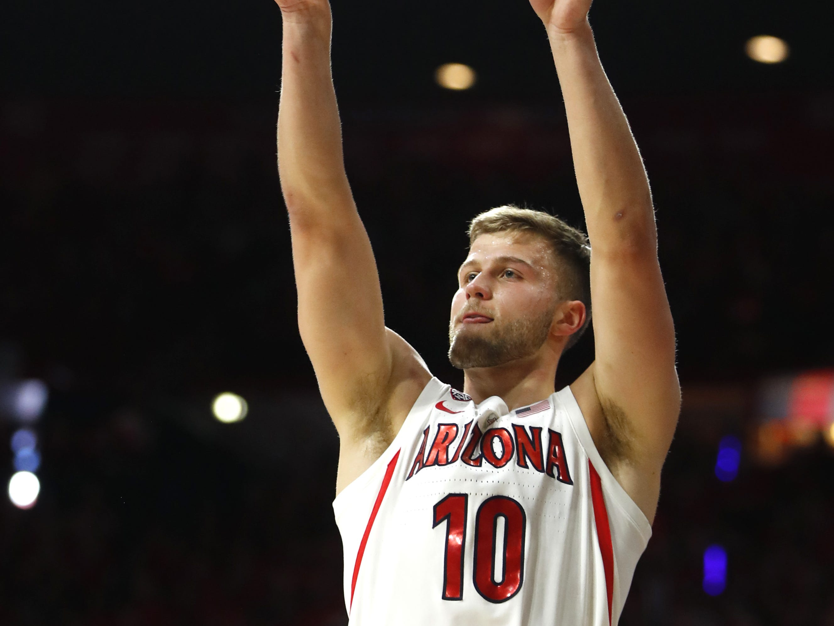 Arizona's Ryan Luther (10) shoots a three pointer against ASU during the first half at the McKale Memorial Center in Tucson, Ariz. on March 9, 2019.