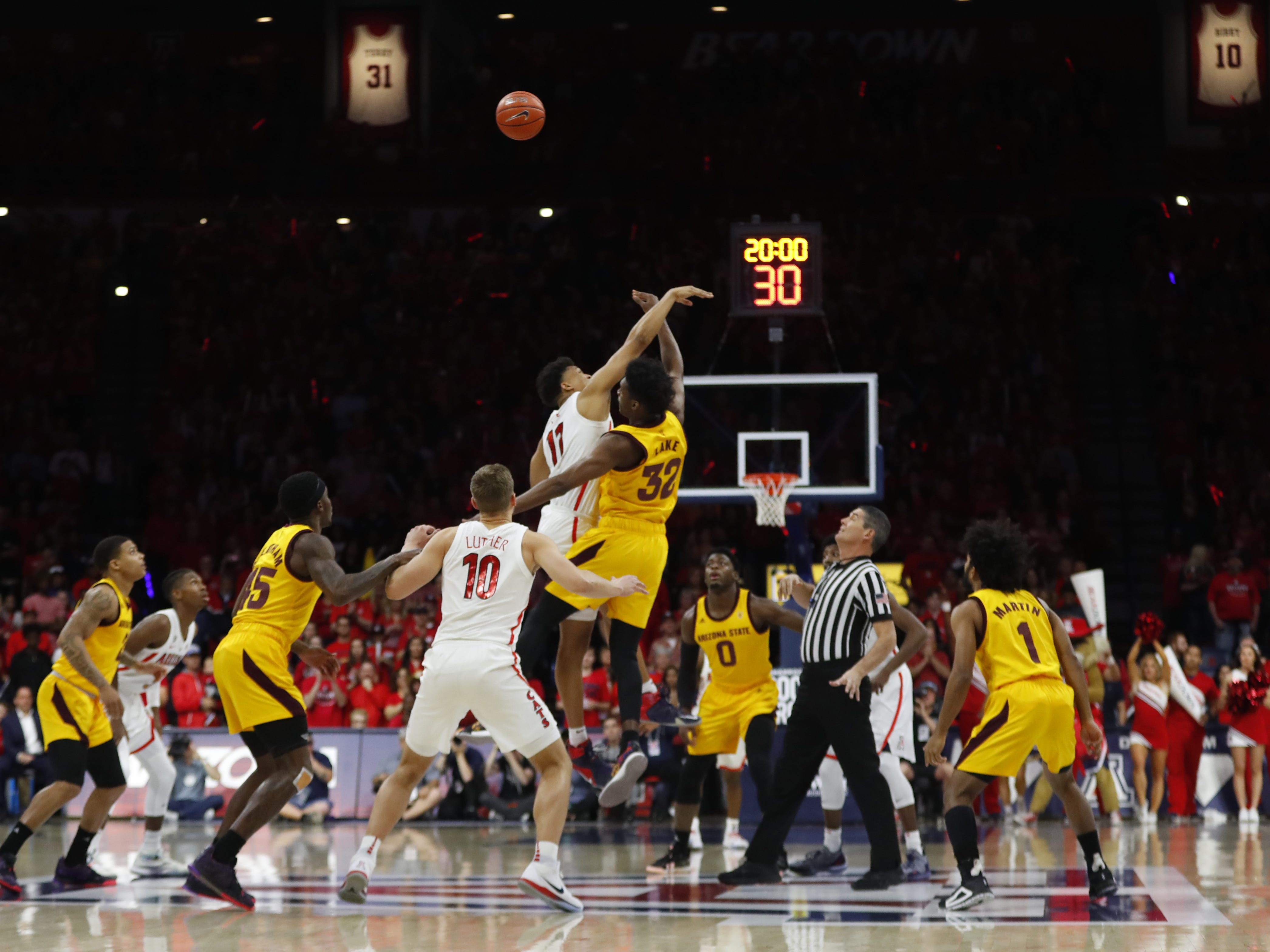 ASU's DeQuon Lake (32) wins the tip against Arizona's Ira Lee during the first half at the McKale Memorial Center in Tucson, Ariz. on March 9, 2019.