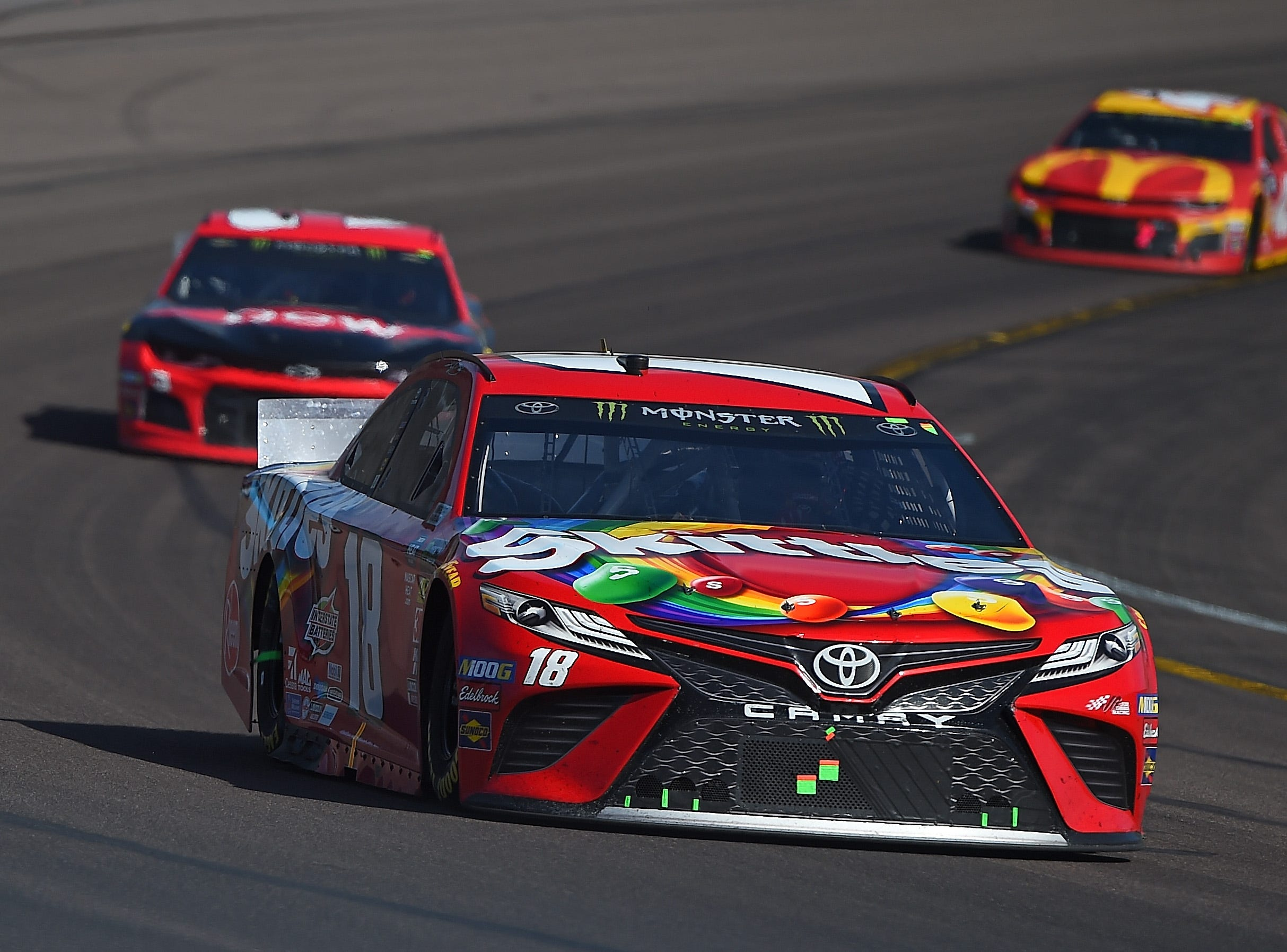 AVONDALE, AZ - MARCH 10:  Kyle Busch, driver of the #18 Skittles Toyota, leads a pack of cars during the Monster Energy NASCAR Cup Series TicketGuardian 500 at ISM Raceway on March 10, 2019 in Avondale, Arizona.  (Photo by Stacy Revere/Getty Images)