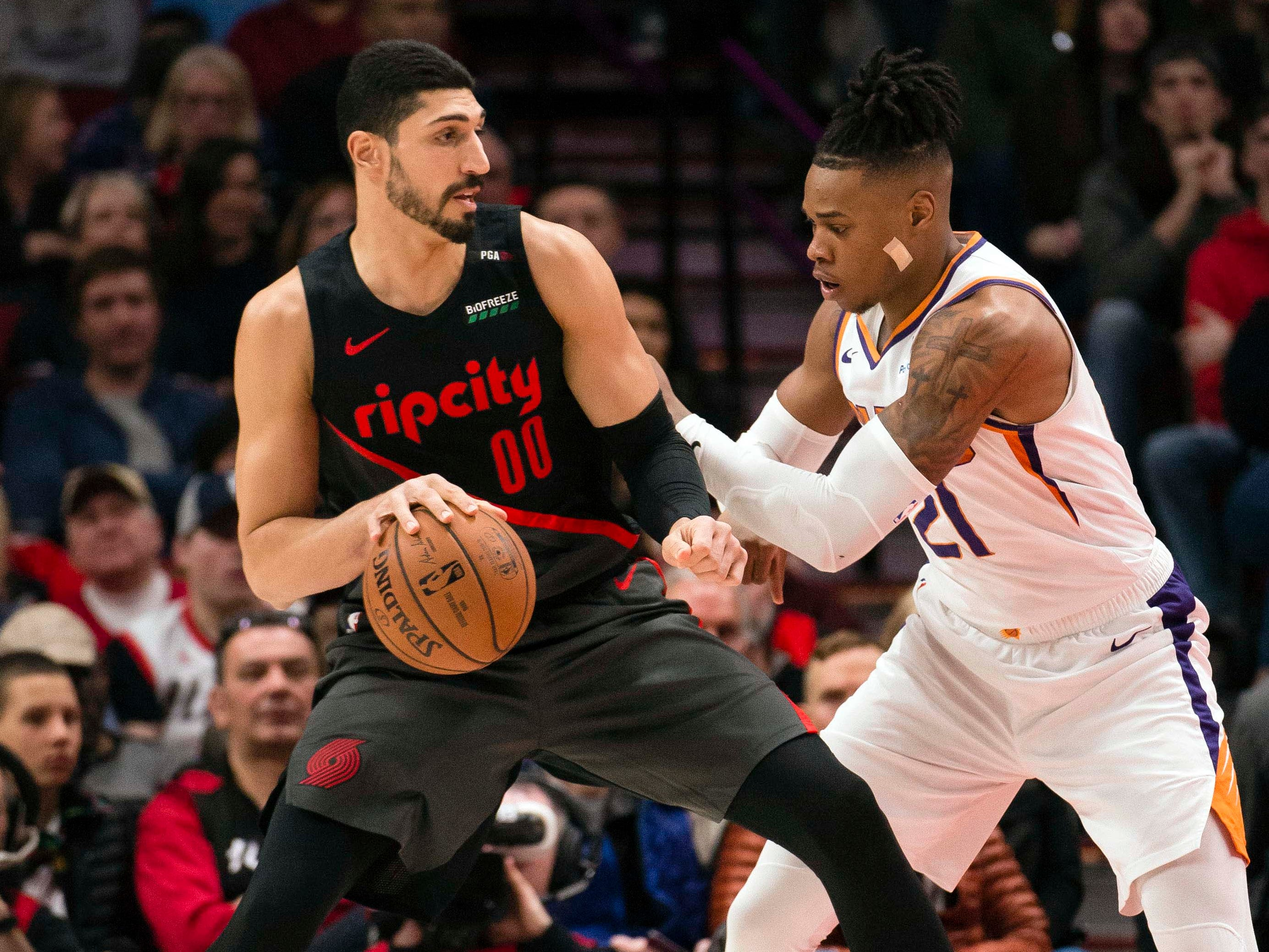 Mar 9, 2019; Portland, OR, USA; Portland Trail Blazers center Enes Kanter (00) drives to the basket against Phoenix Suns forward Richaun Holmes (21) during the first half at Moda Center.