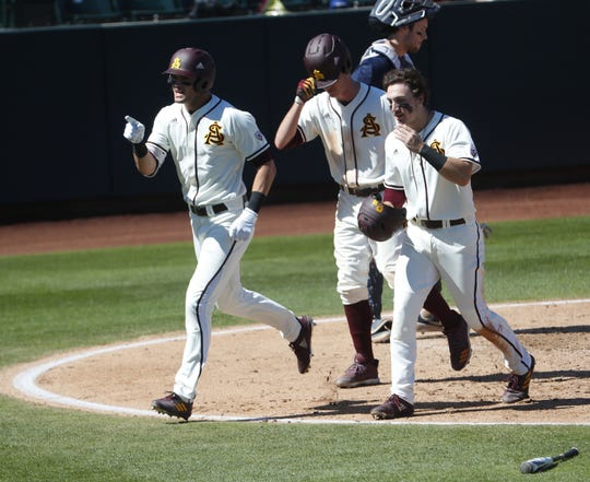 ASU's Hunter Bishop (4) celebrates with Erik Tolman (15) and Trevor Hauver (18) after hitting a three run home run during the third inning of a game against Xavier at Phoenix Municipal Stadium in Phoenix, Ariz. on March 10, 2019.