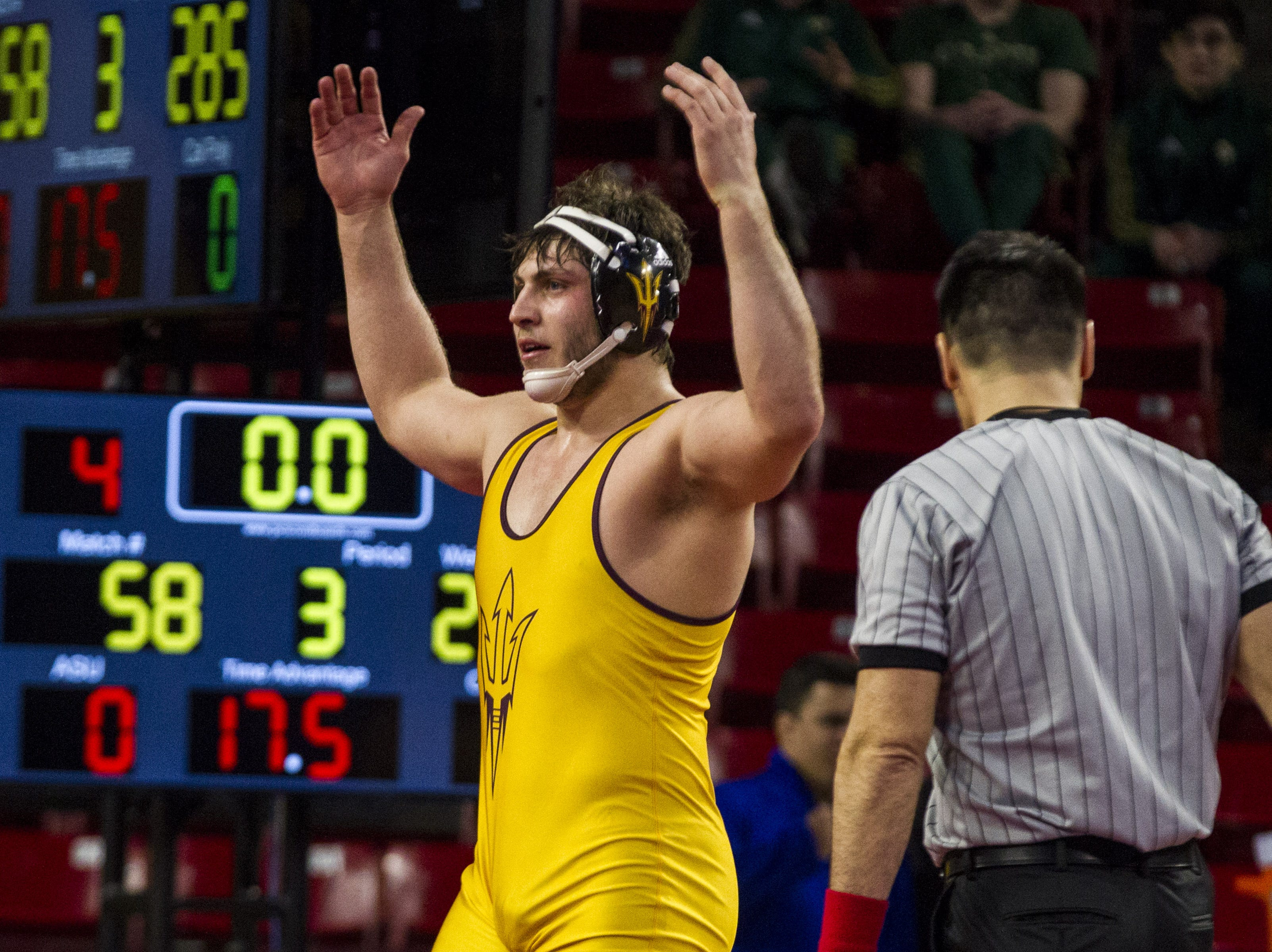 ASU heavyweight Brady Daniel celebrates his third place win over Cal Poly's Sam Aguilar during the Pac 12 Wrestling Championship at Wells Fargo Arena in Tempe on March 9, 2019.