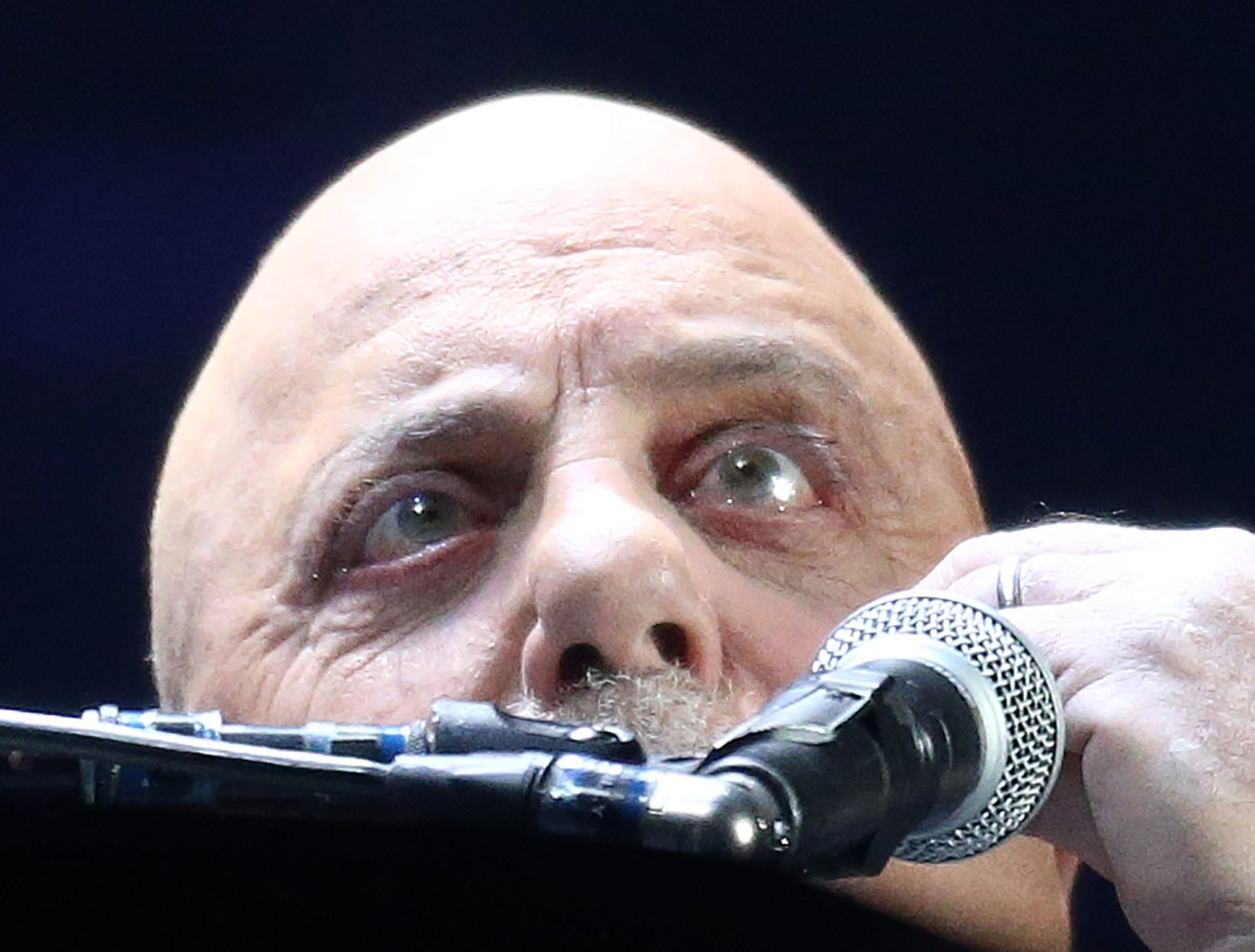 Musician Billy Joel watches a little white moth as he performs at Chase Field on March 9, 2019, in Phoenix.