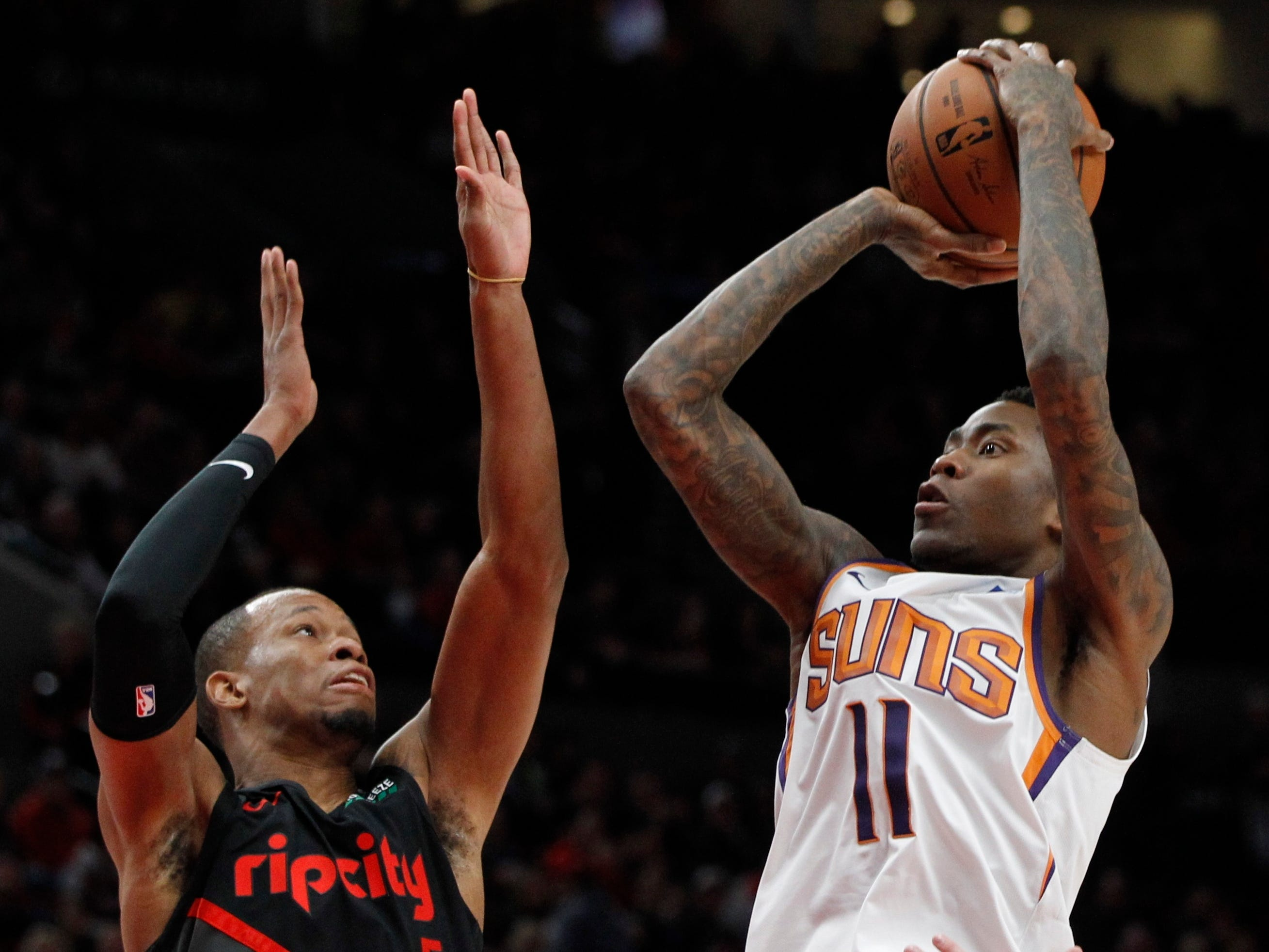 Phoenix Suns guard Jamal Crawford, right, shoots as Portland Trail Blazers guard Rodney Hood defends during the first half of an NBA basketball game in Portland, Ore., Saturday, March 9, 2019.
