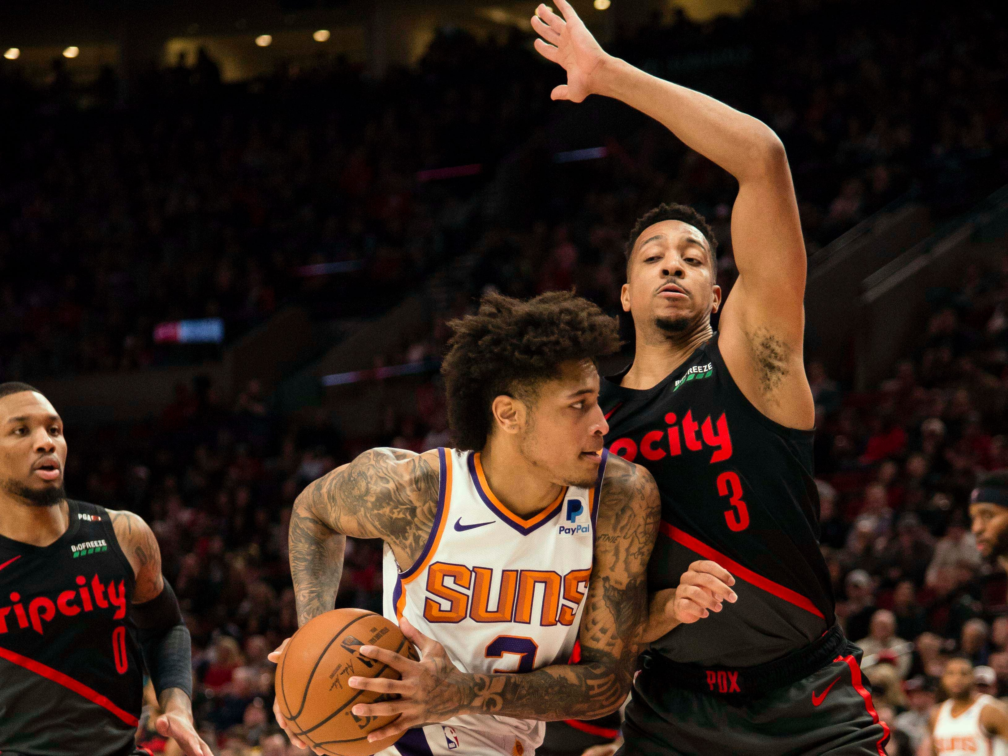 Mar 9, 2019; Portland, OR, USA; Phoenix Suns forward Kelly Oubre Jr. (3) drives to the basket against Portland Trail Blazers guard CJ McCollum (3) during the first half at Moda Center.