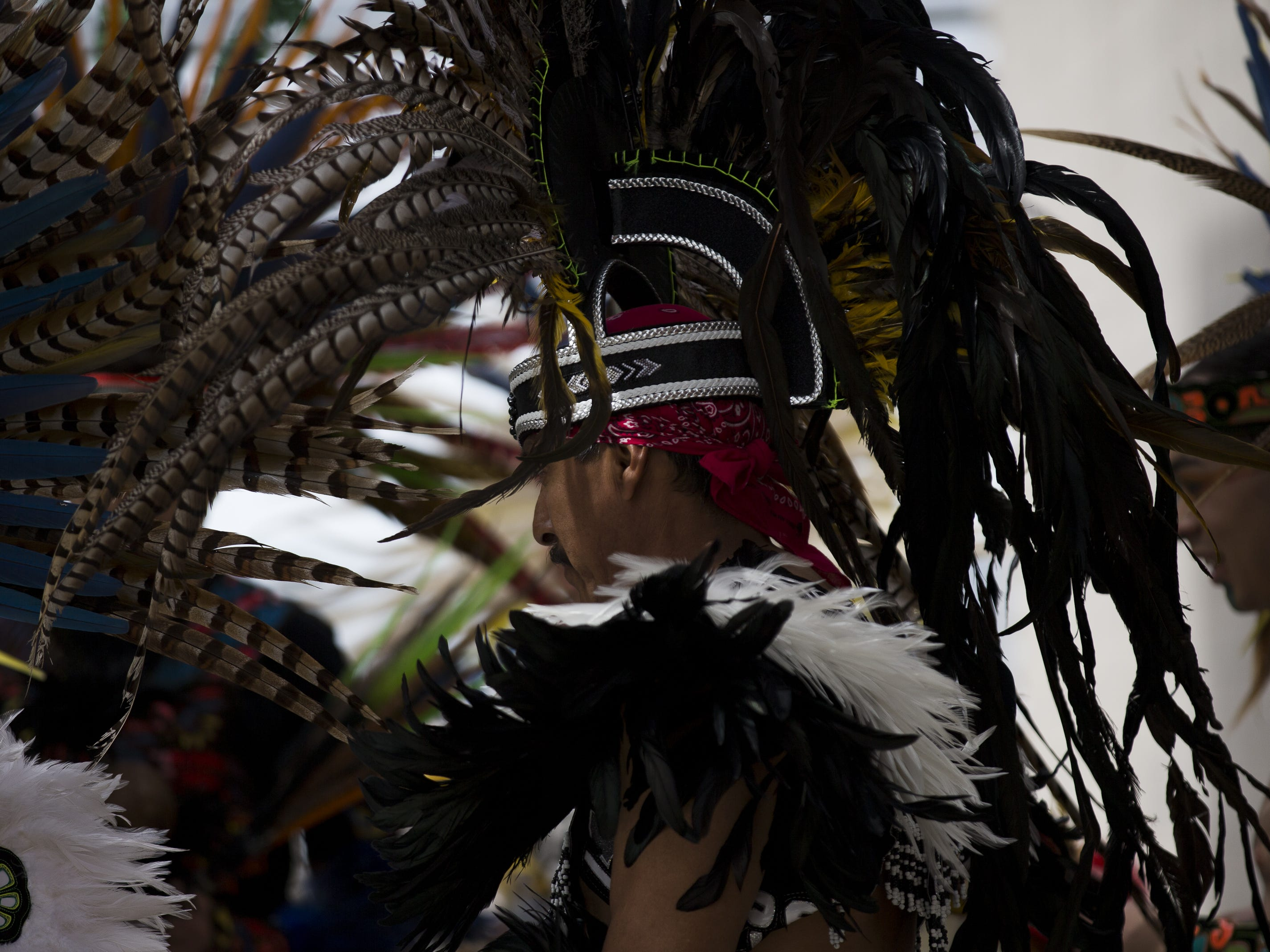 Members of an Aztec dance group prepare to perform at the Native Two Spirit Powwow at South Mountain Community College in Phoenix, Ariz. on Saturday, March 9, 2019. The powwow was the first of its kind in Arizona, featuring members who identified as two spirit, and members who did not, dancing together.