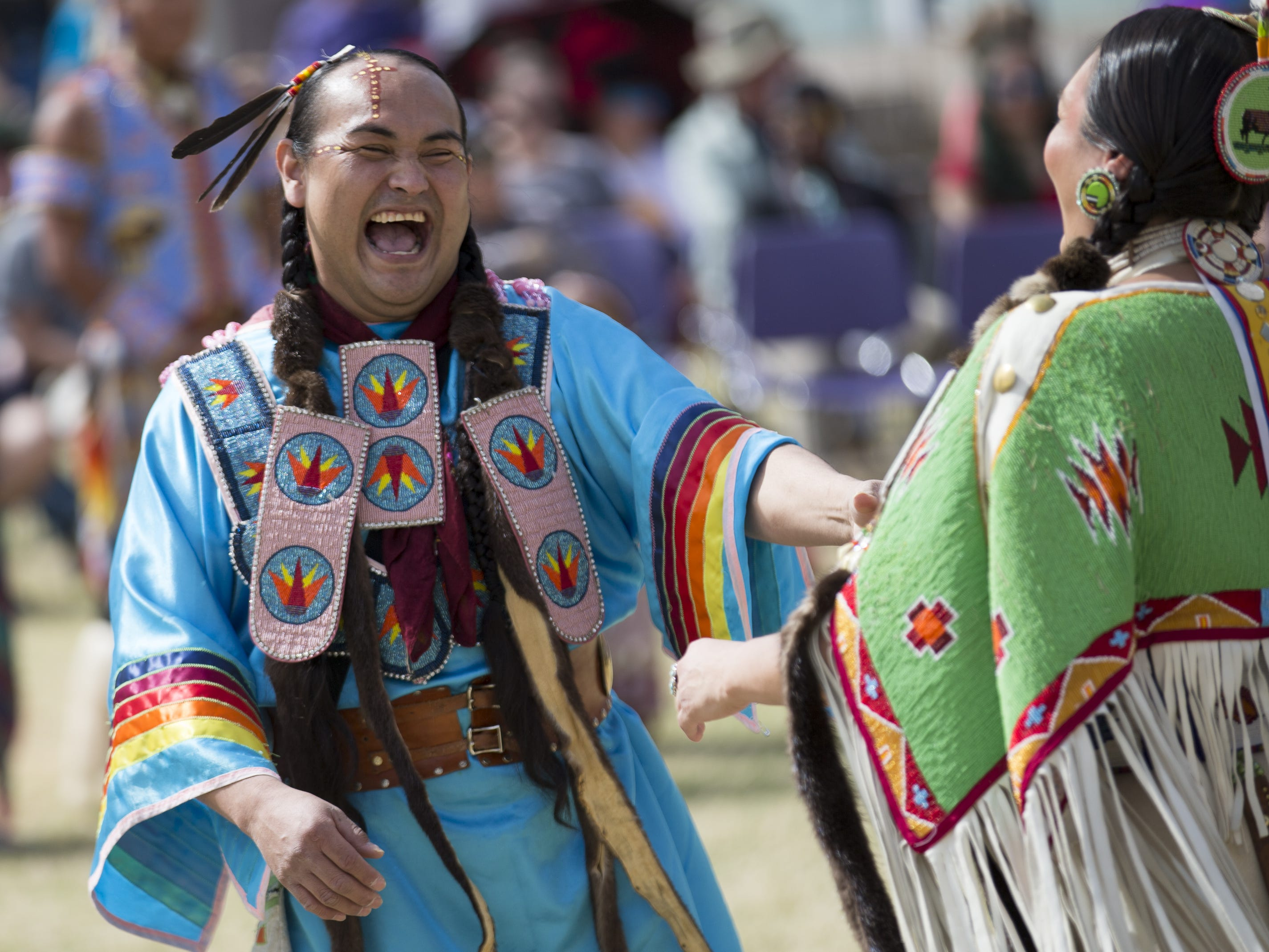 John Sneezy of the San Carlos Apache tribe (left) dances at the Native Two Spirit Powwow at South Mountain Community College in Phoenix, Ariz. on Saturday, March 9, 2019. The powwow was the first of its kind in Arizona, featuring members who identified as two spirit, and members who did not, dancing together.
