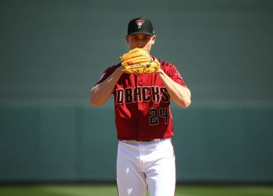 Arizona Diamondbacks pitcher Luke Weaver prepares to throw to the Cincinnati Reds in the first inning during a spring training game on Mar. 4, 2019, at Salt River Fields in Scottsdale, Ariz.
