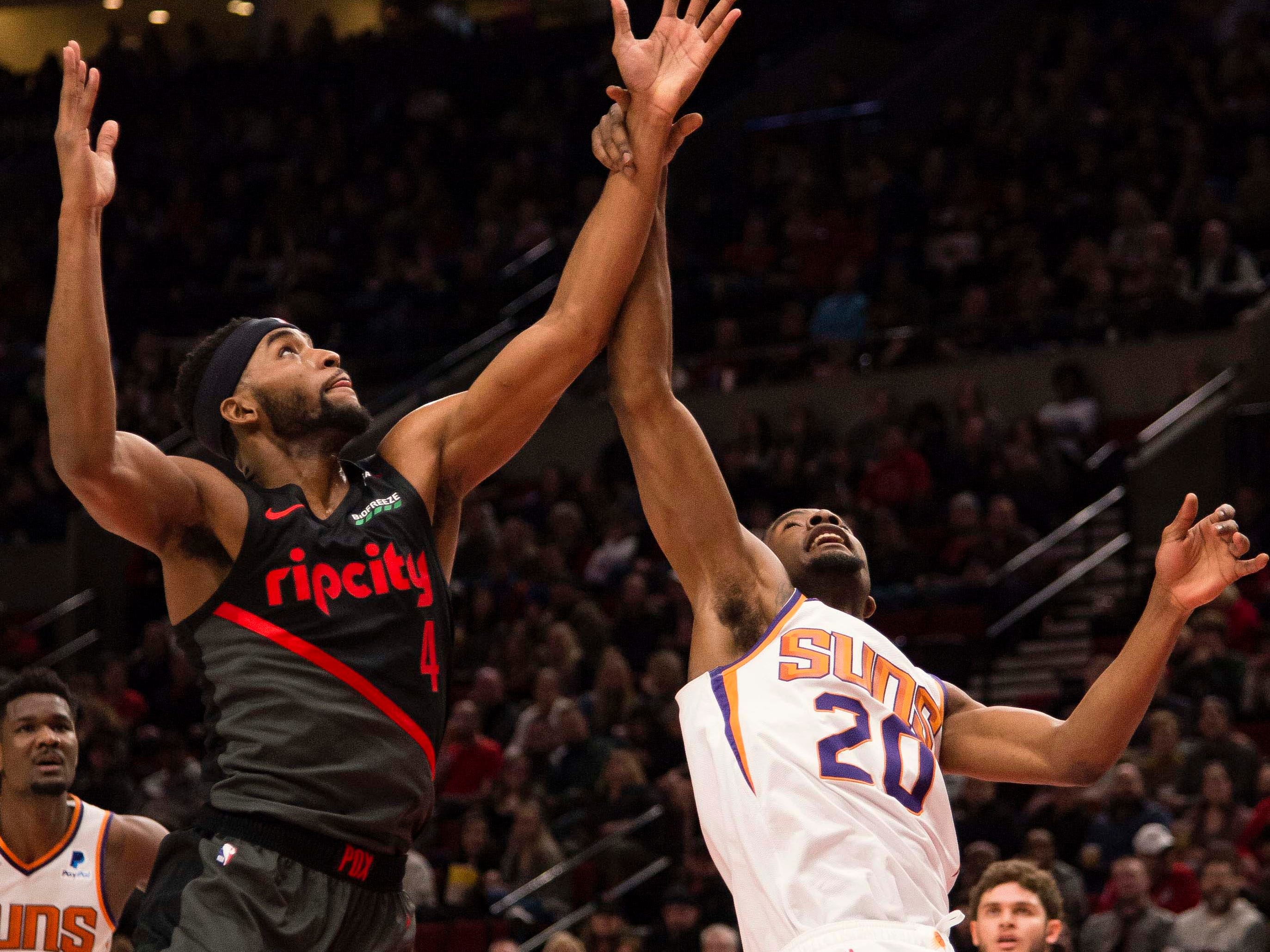 Mar 9, 2019; Portland, OR, USA; Phoenix Suns forward Josh Jackson (20) scrambles for a rebound against Portland Trail Blazers forward Maurice Harkless (4) during the first half at Moda Center.