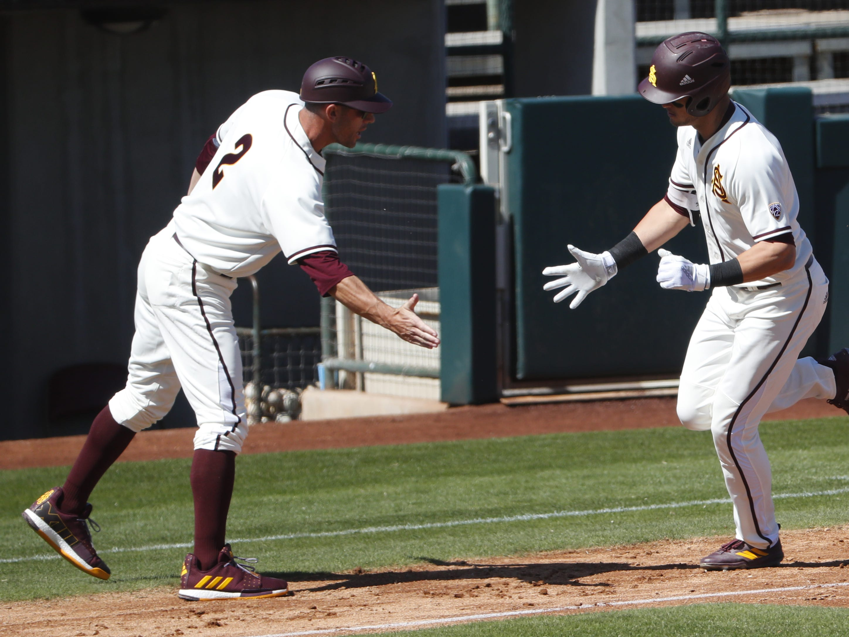 ASU's Hunter Bishop (4) rounds third base after hitting a three run home run in the third inning during a game against Xavier at Phoenix Municipal Stadium in Phoenix, Ariz. on March 10, 2019.