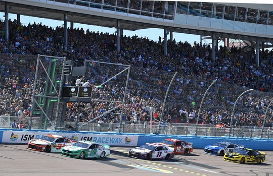 Ryan Blaney (12) and Chase Elliott (9) lead the field to the green flag for the start of the TicketGuardian 500 at ISM Raceway.