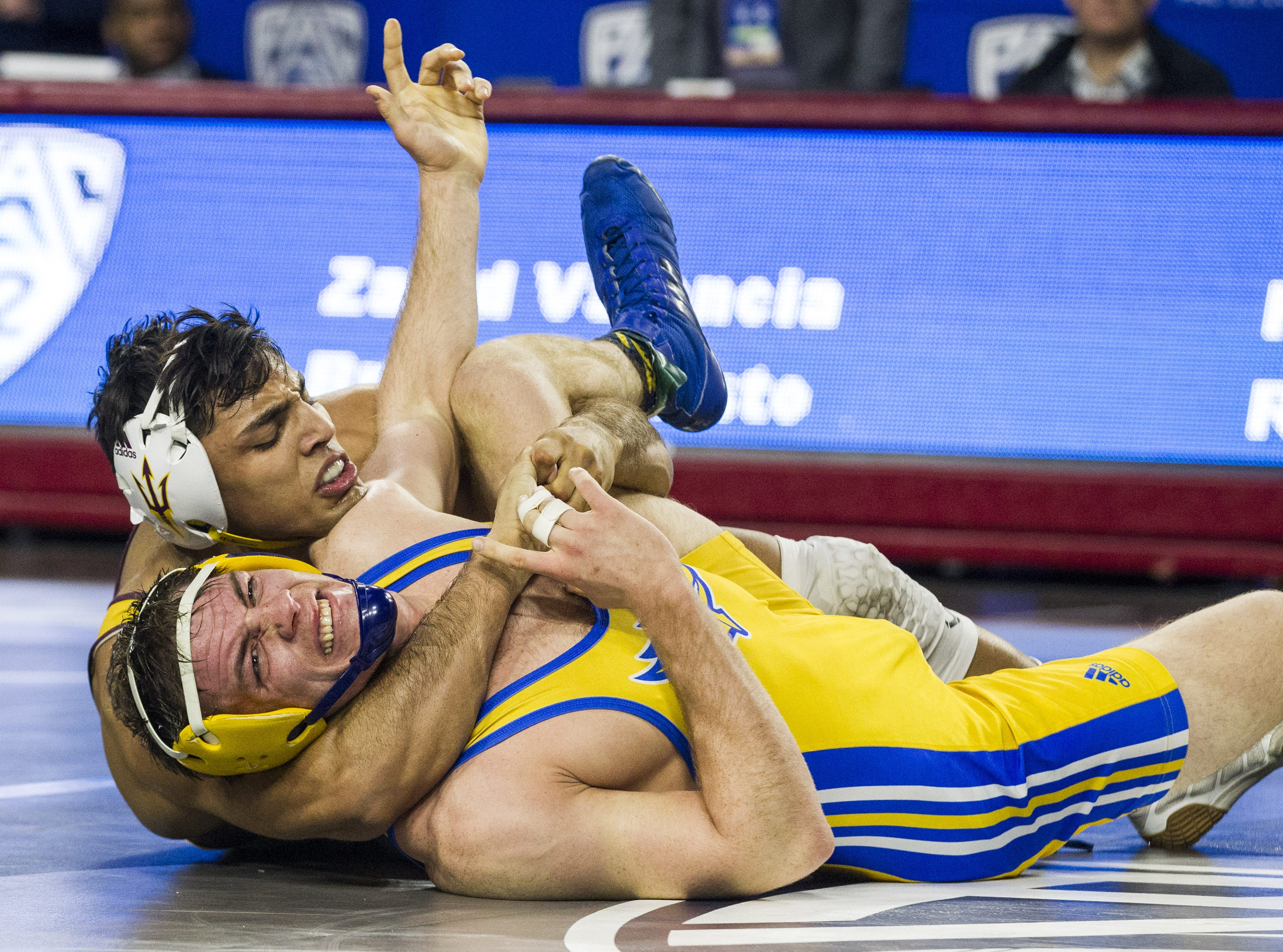 The PAC 12's Most Outstanding wrestler ASU's Zahid Valencia wraps up CSU Bakersfield's Bryan Battisto to win the 174 pound weight class during the Pac 12 Wrestling Championship at Wells Fargo Arena in Tempe on March 9, 2019.