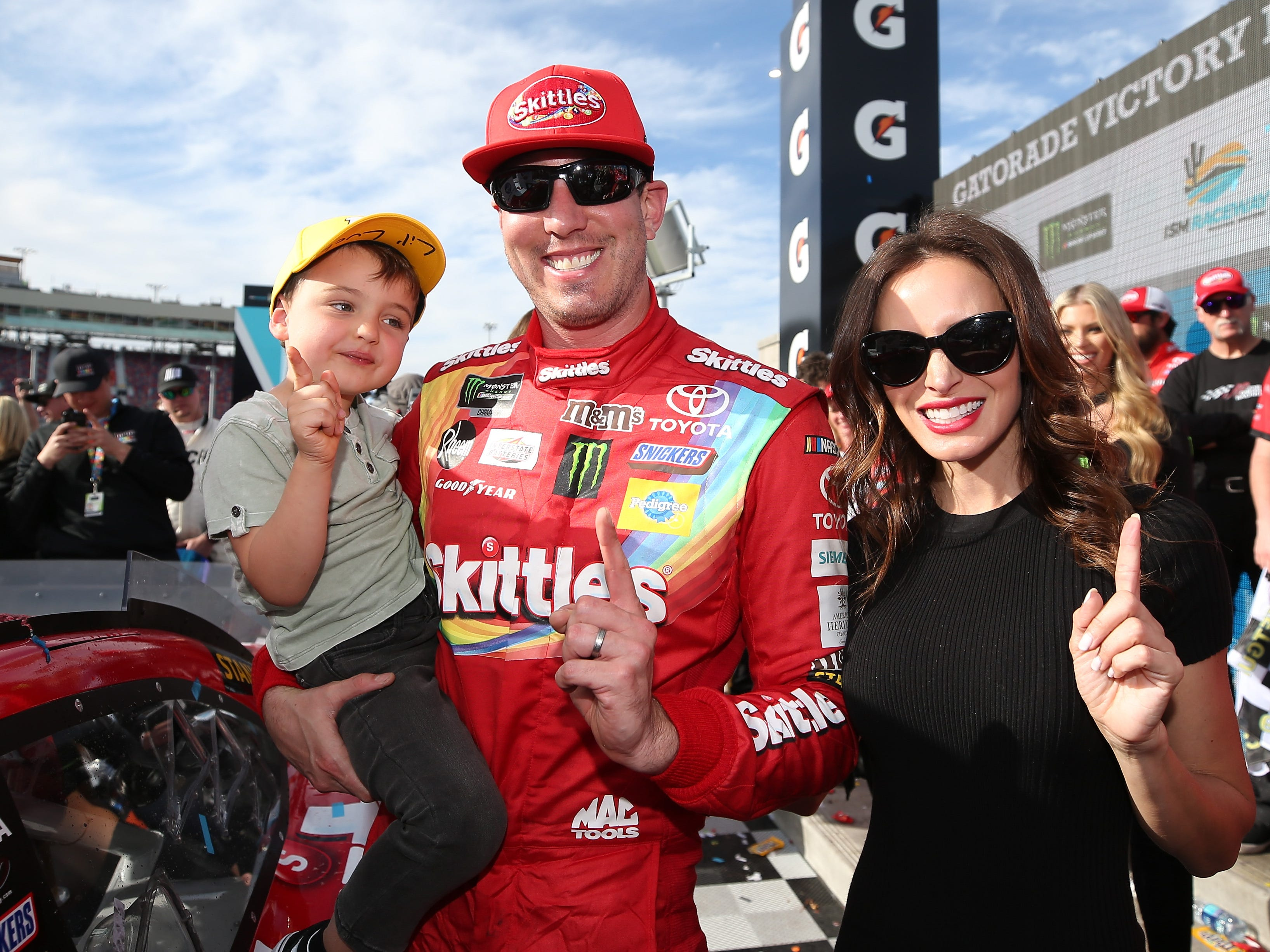 AVONDALE, AZ - MARCH 10:  Kyle Busch, driver of the #18 Skittles Toyota, celebrates with his wife, Samantha, and son, Brexton, after winning the Monster Energy NASCAR Cup Series TicketGuardian 500 at ISM Raceway on March 10, 2019 in Avondale, Arizona.  (Photo by Matt Sullivan/Getty Images)