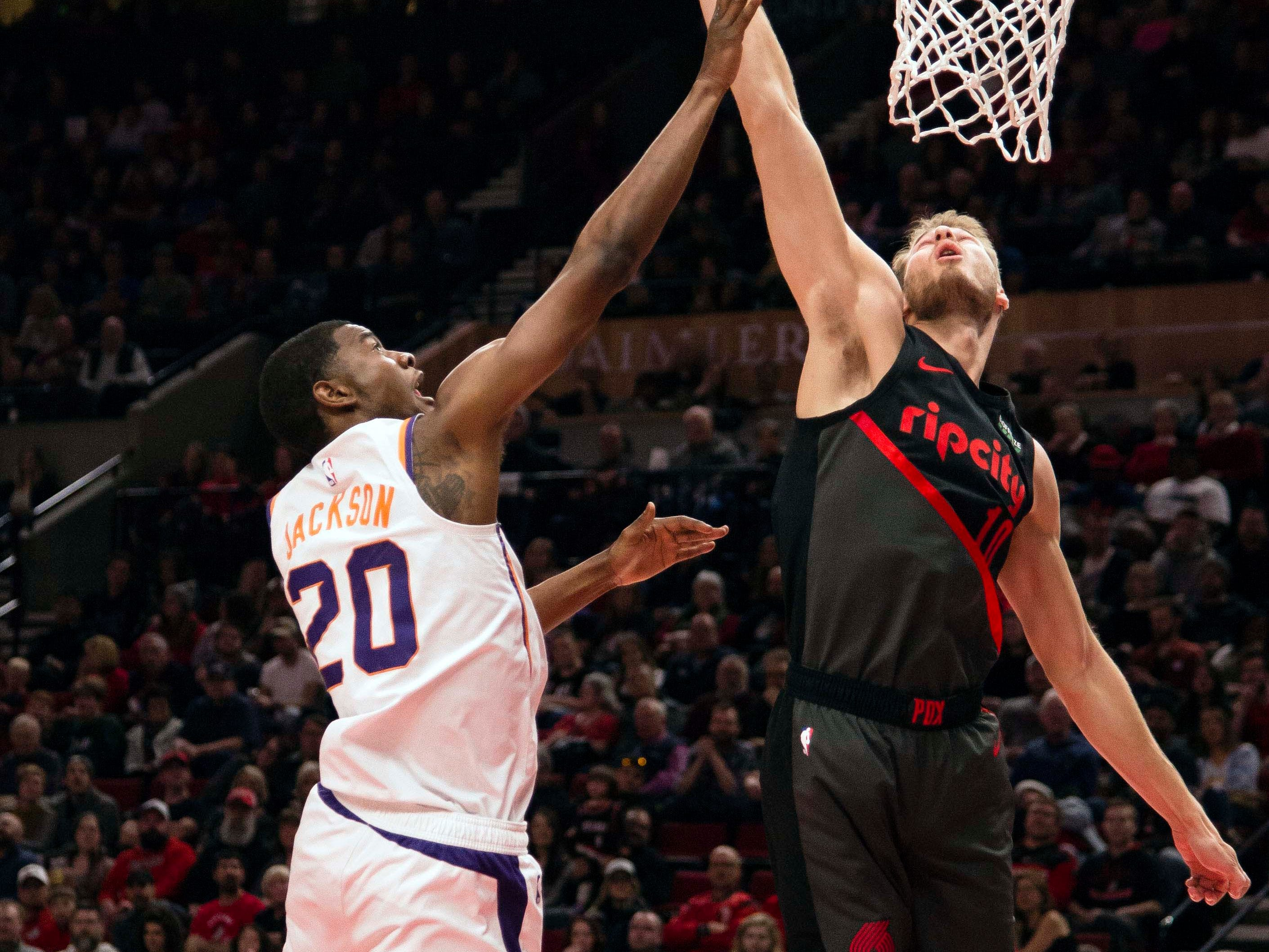 Mar 9, 2019; Portland, OR, USA; Portland Trail Blazers forward Jake Layman (10) blocks a shot by Phoenix Suns forward Josh Jackson (20) during the first half at Moda Center.